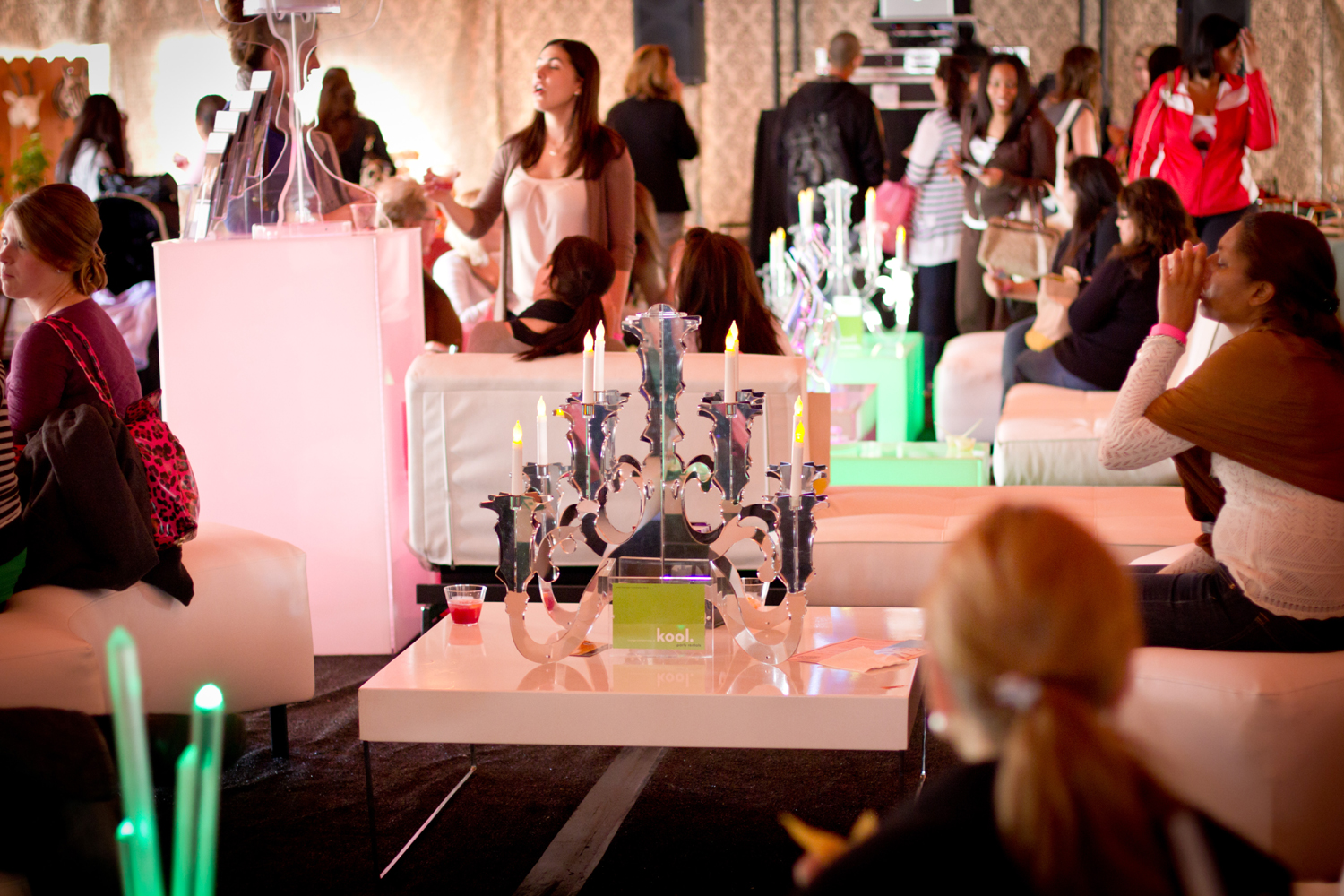 Lively and comfortable sponsor spaces attact attendees like flies to honey like at this  kool party rentals  lounge at the Hard Rock Hotel  Wedding Party EXPO