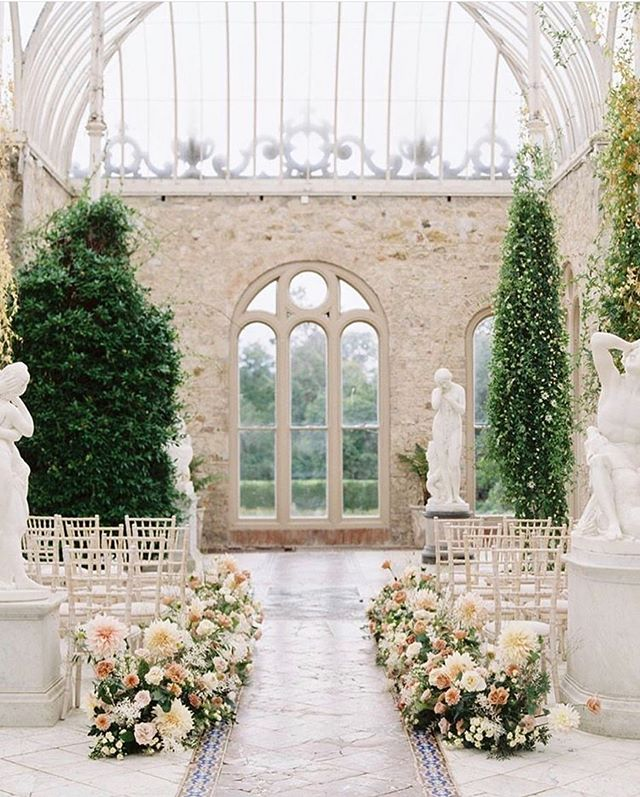 The orangery where Sally and Taylor promised each other forever ✨  @killruddery was the perfect setting for celebration, but also an immersive experience for our design team while working in Ireland. We felt kindness and graciousness in droves from any employee we met, we designed in the coziest grain store on property, we enjoyed farm to table bites from the tea room and farm shop, and got lost in the beauty of the formal and cut flower gardens (Killruddery grew the show stopping cafe ah lait dahlias). We came alongside incredible talent to create a memorable guest experience for Sally and Taylor's intimate wedding day.  Film: @sophiekayephotography (followed by iPhone shots from our week) @killruddery  @houseofhannahevents  @malloryfitzgeraldmua @sweetolivefloral  @victoriaaustindesigns