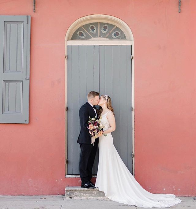 S + K lingering for kisses in this French Quarter doorway with her bridal bouquet in hand // planning: @vanessanoelevents photography: @annadelores