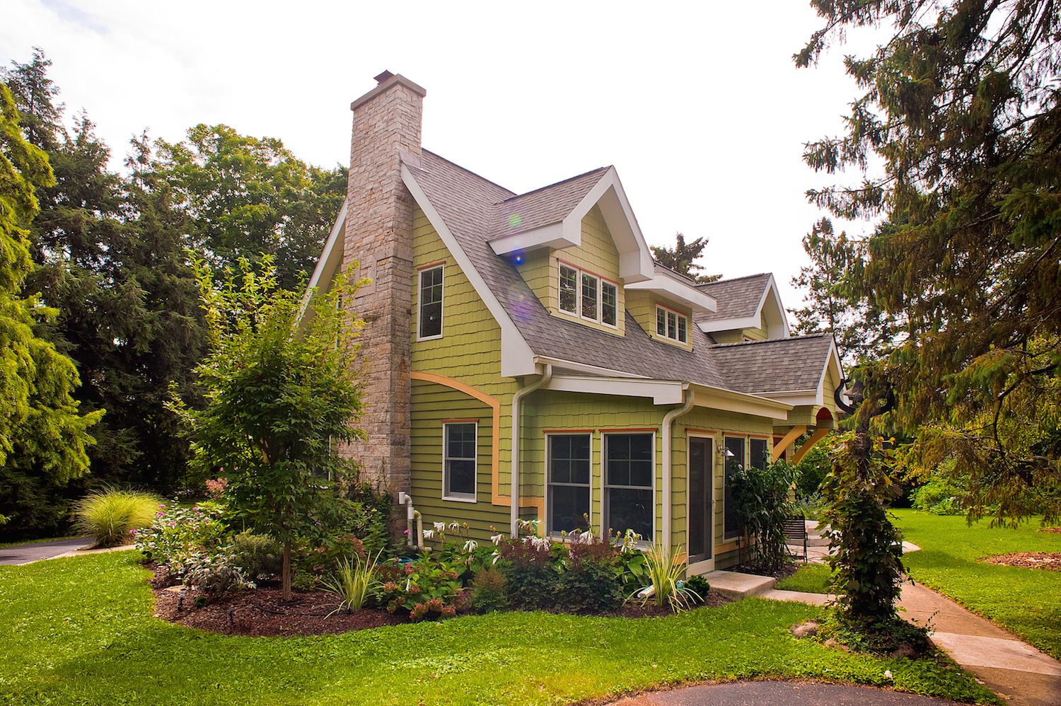The tan banding around the home's exterior provide visual interest and separation of different siding types.