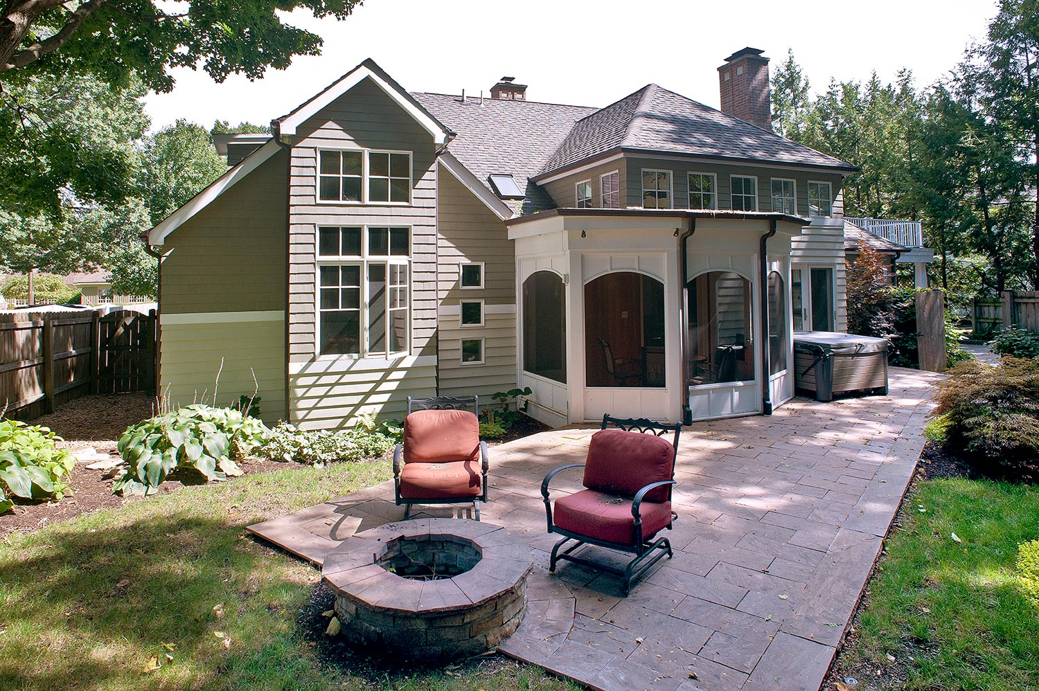 Distinctive window placement carries the home's design through to the back yard.