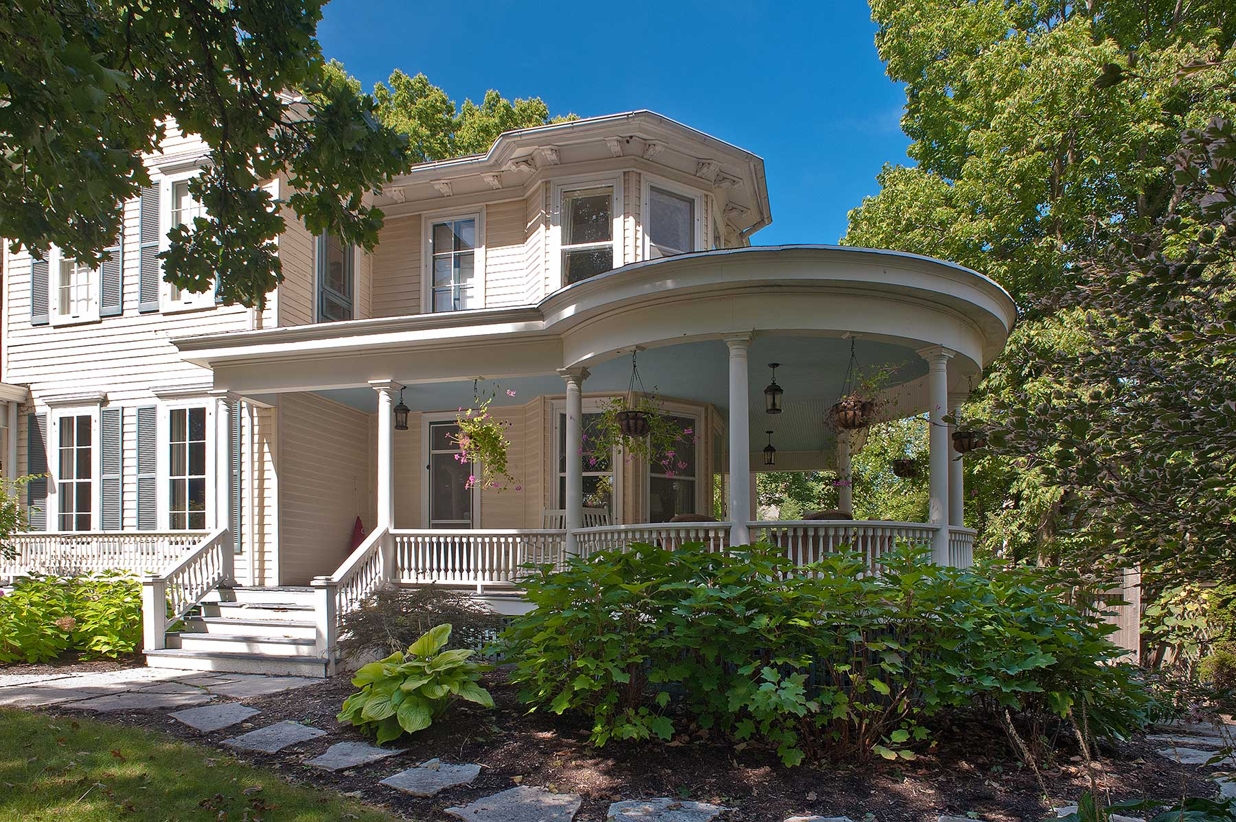 Using historic photos, a replacement porch was created to re-create some of the slpendor of this 1850s doctor's home.