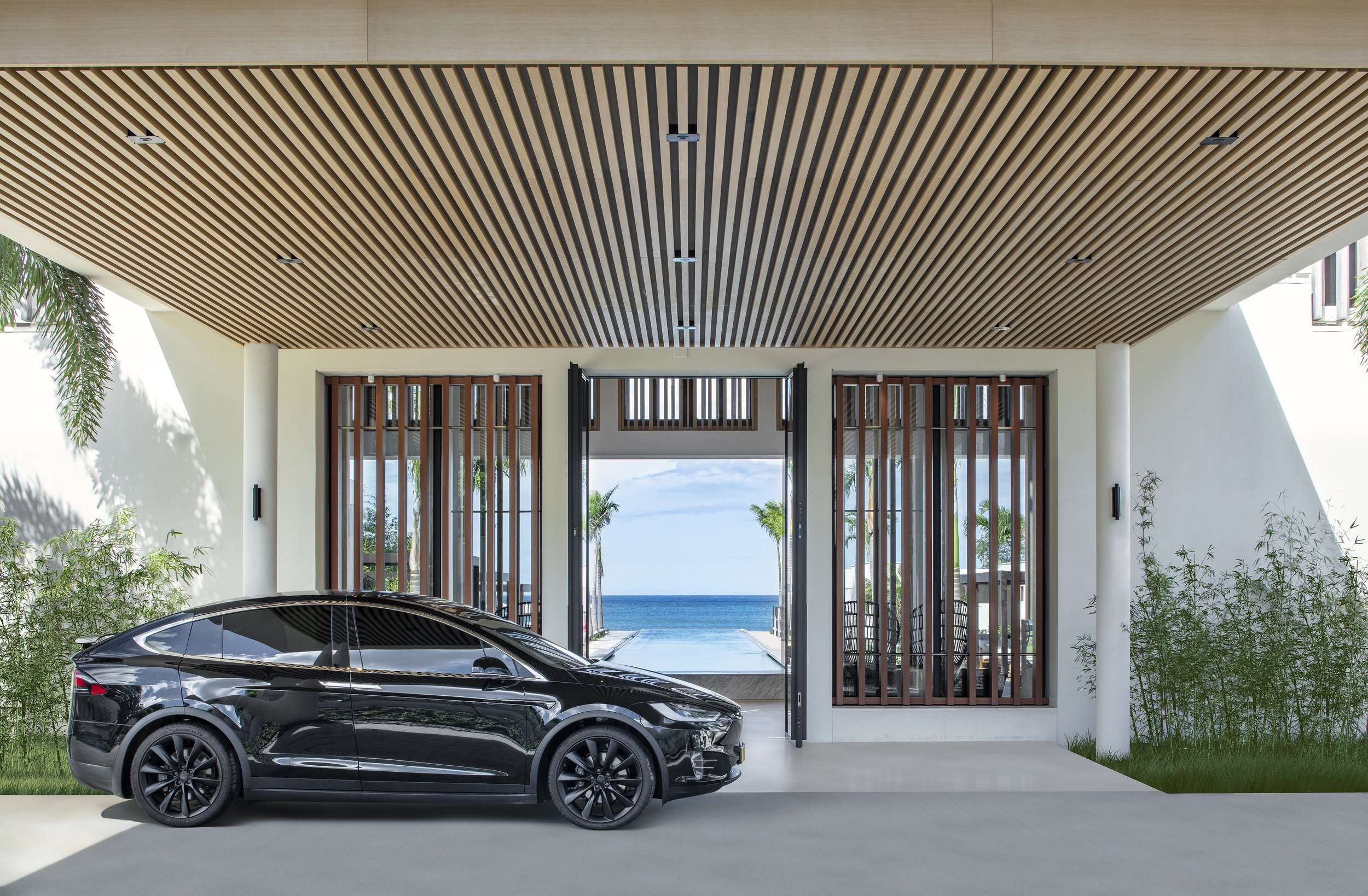 Entrance to hotel with Tesla.jpg
