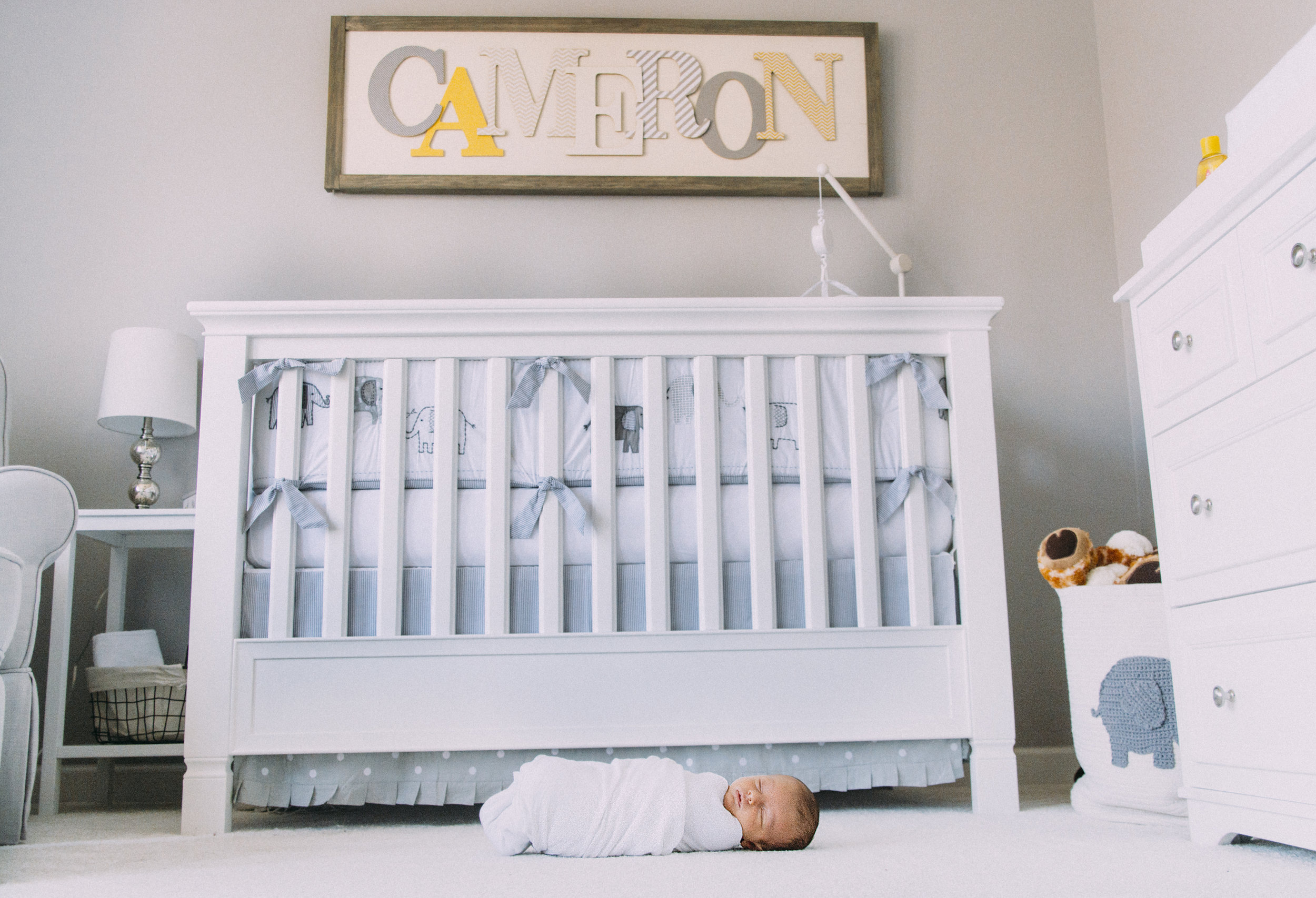 Copy of Sequins Photography Charlotte, NC lifestyle newborn photographerThings to consider when planning for a newborn lifestyle session. Clean nursery color pallet with a simple design.