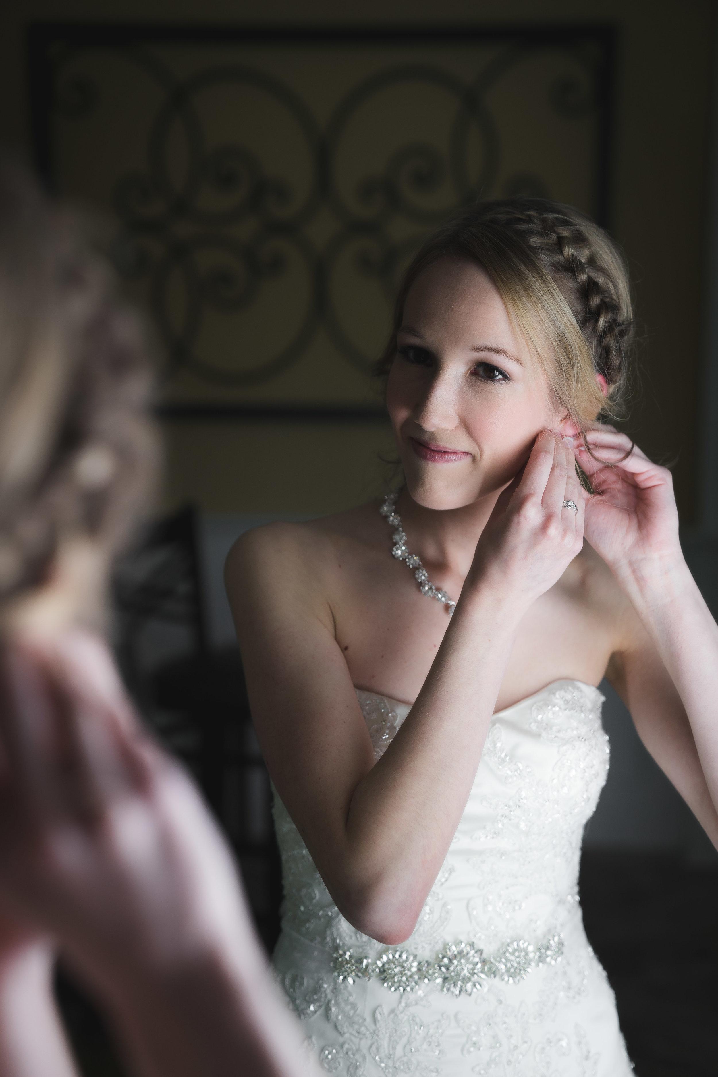 Greenville Wedding | Morningside Baptist Church Spartanburg SC Bride putting on earings