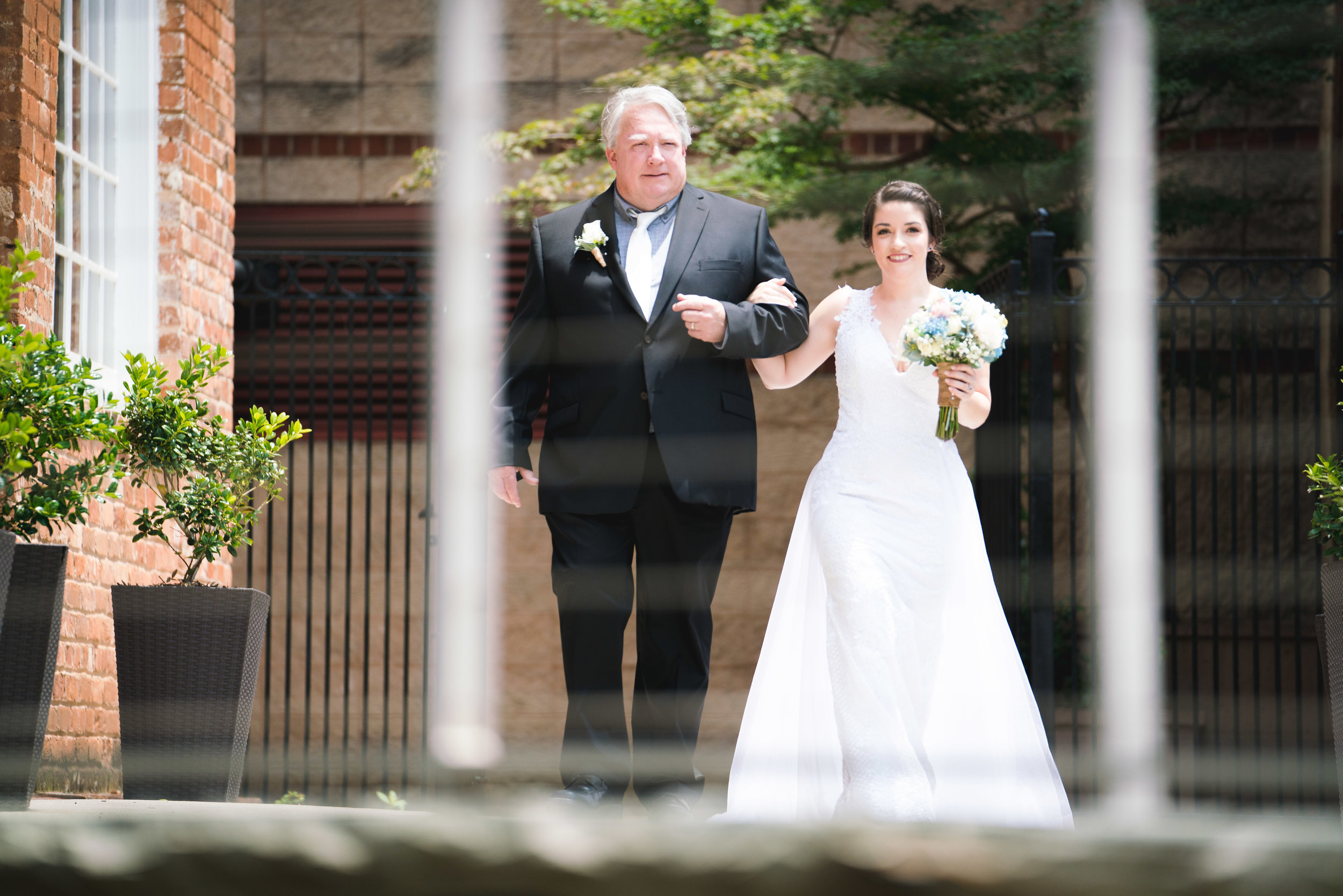 Father and bride entering wedding, Larkins on the River Downtown Greenville Wedding