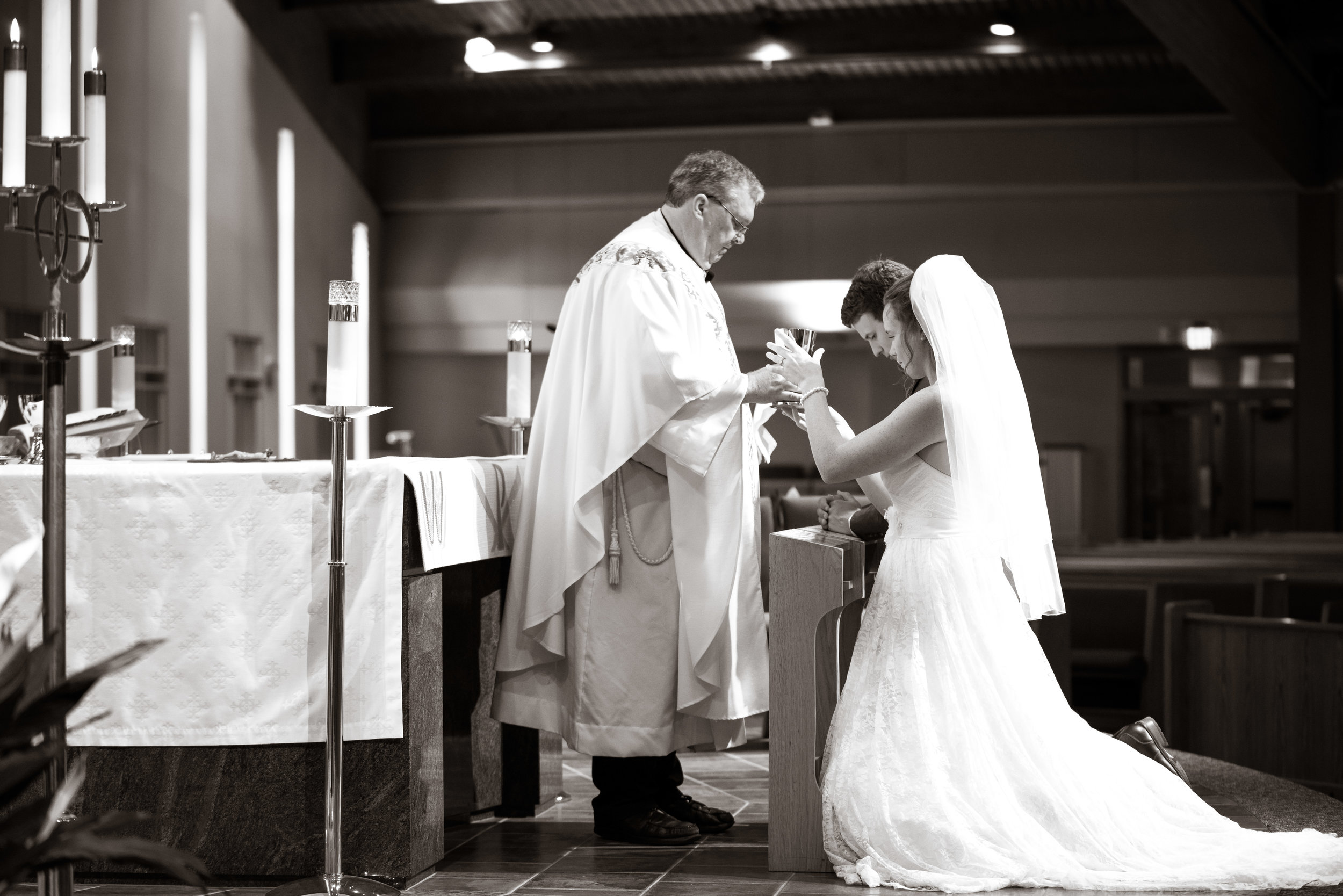 Bride and priest at the alter | St Mary Magdalene Catholic Church Simpsonville, SC
