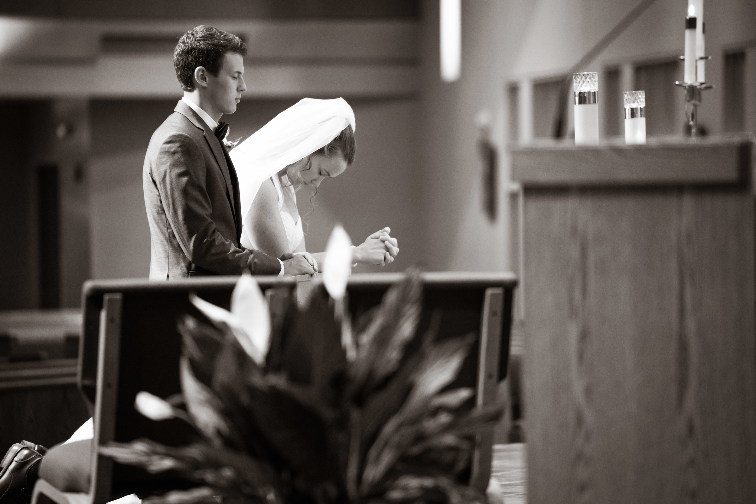 Bride and groom praying at the alter | St Mary Magdalene Catholic Church Simpsonville, SC