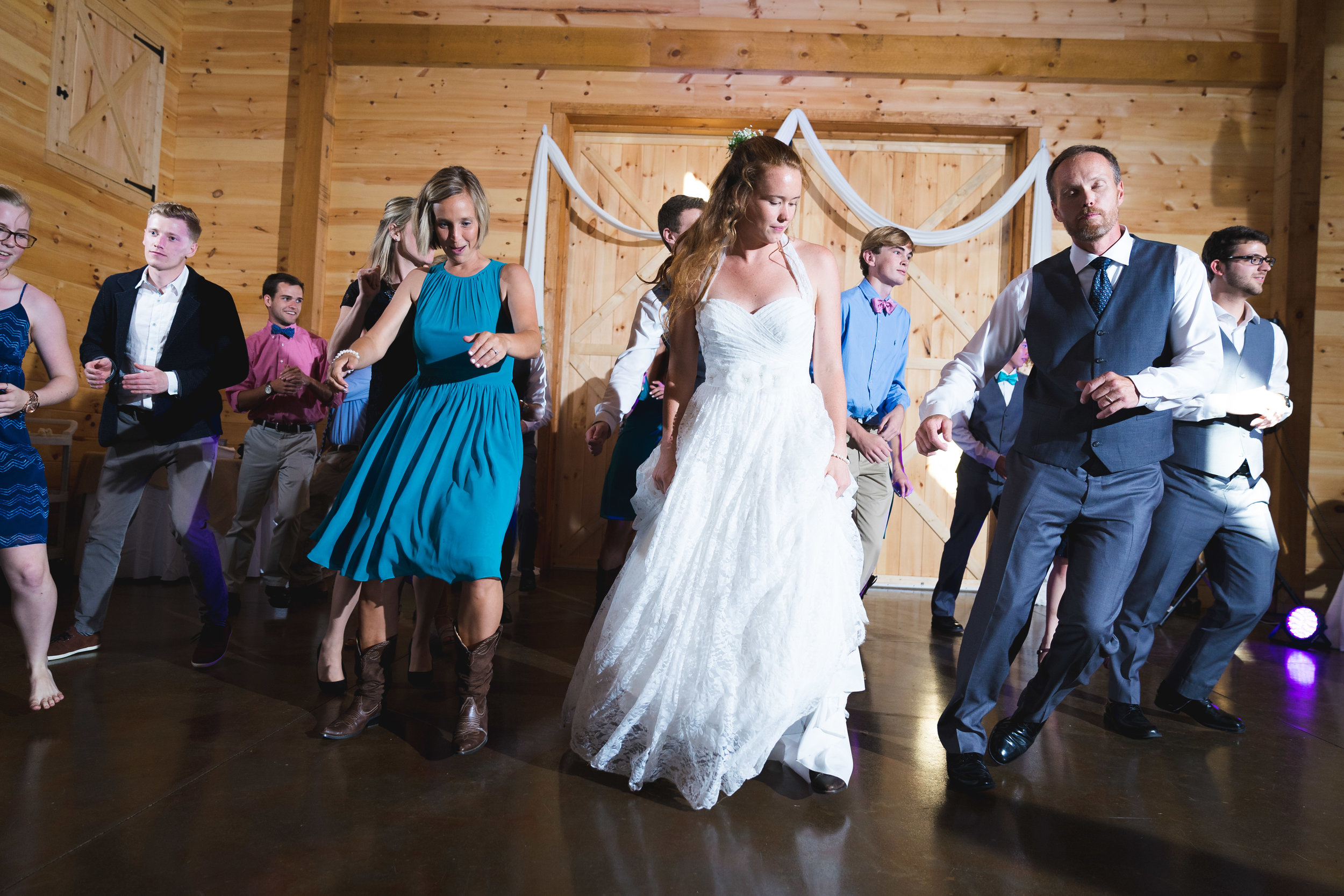 Bride dancing at reception | Windy Hill Wedding and Event Barn in Simpsonville, SC