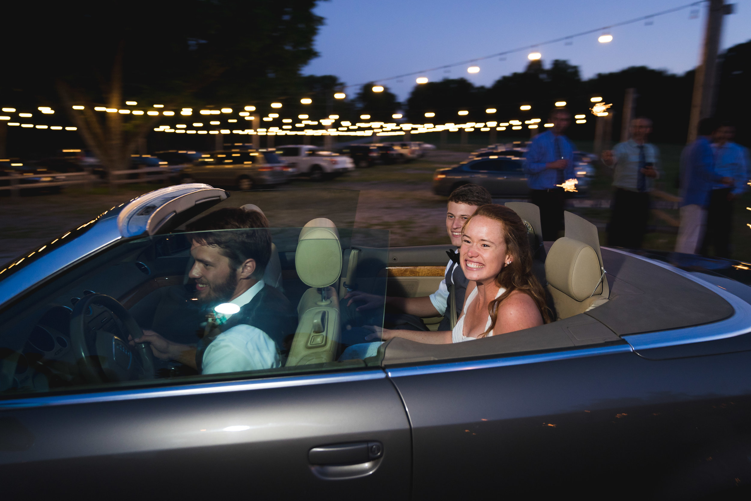 Bride and groom leaving in getaway car | Windy Hill Wedding and Event Barn in Simpsonville, SC