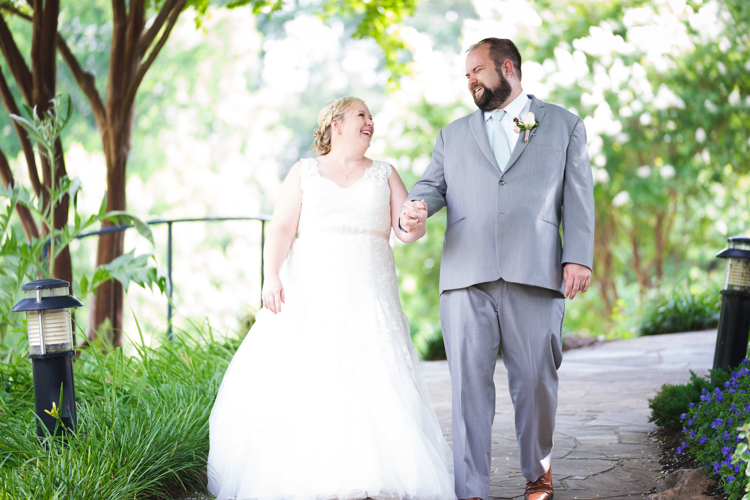 Bride and groom walking | Falls Park Downtown Greenville
