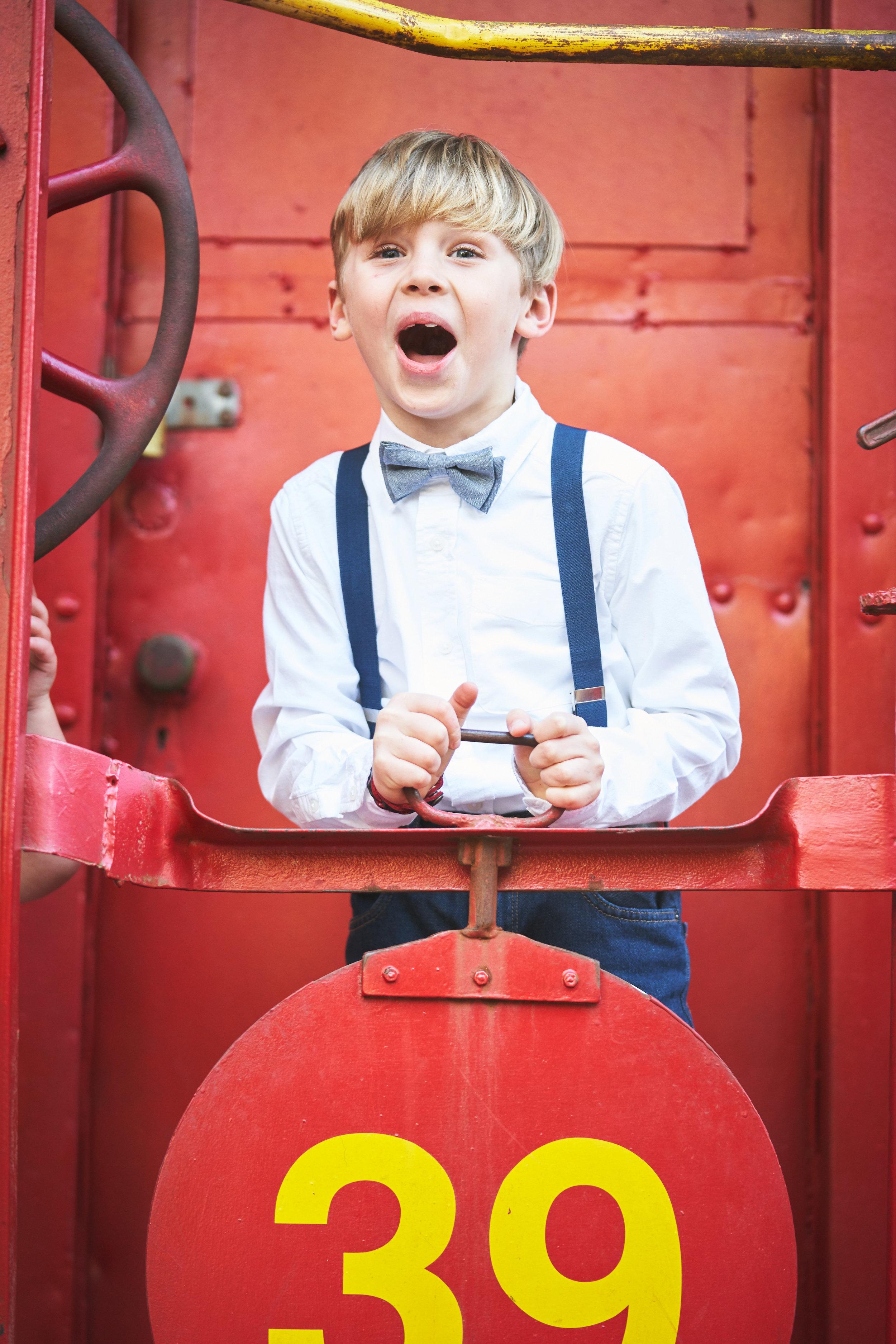 Boy on train| Family Photo Session at the Clemson Botanical Gardens