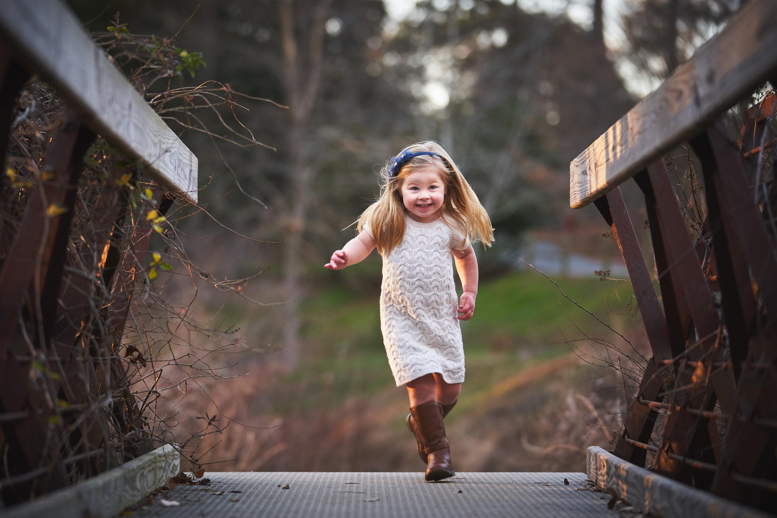 Little girl running | Family Photo Session at the Clemson Botanical Gardens
