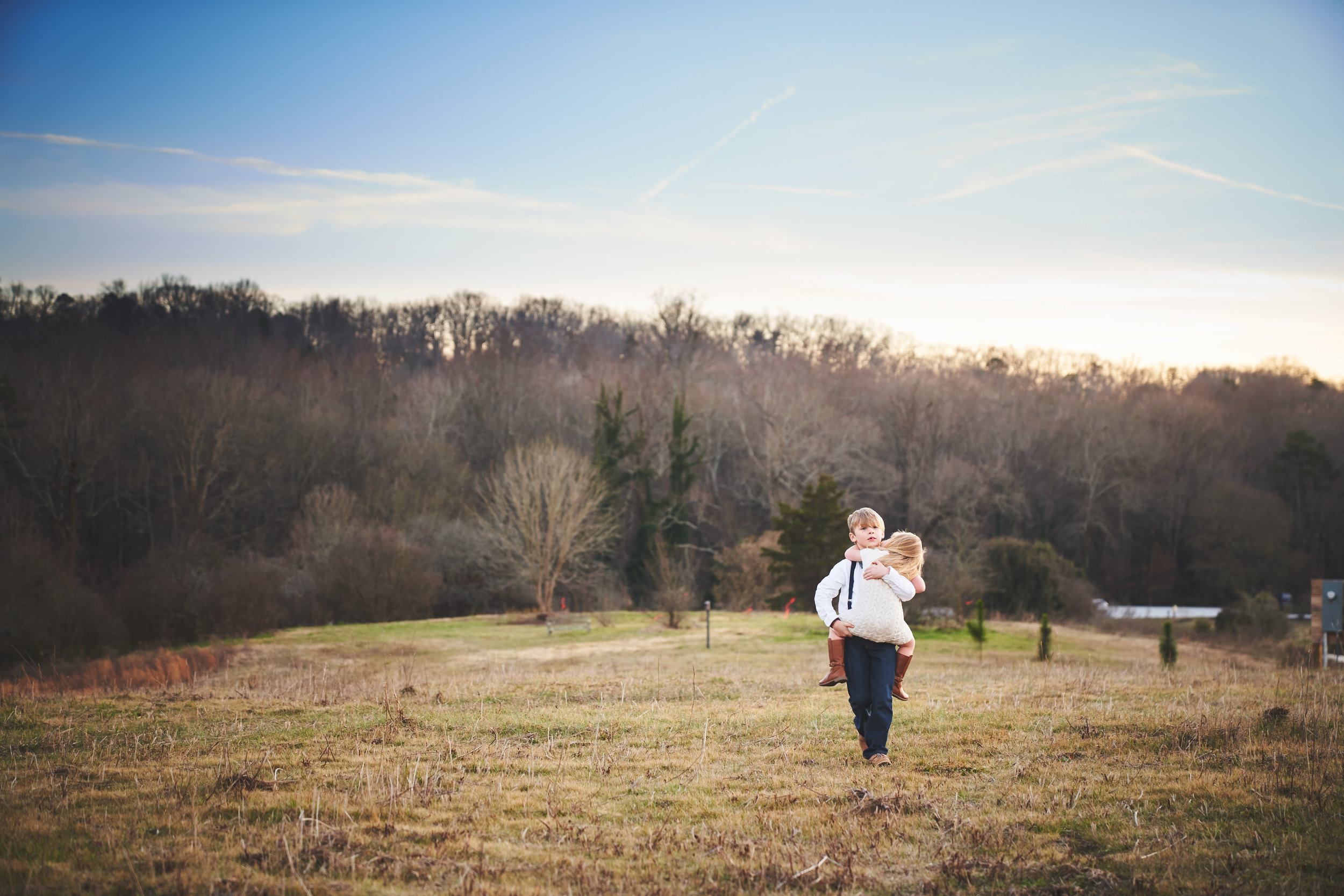 Brother carrying sister | Family Photo Session at the Clemson Botanical Gardens