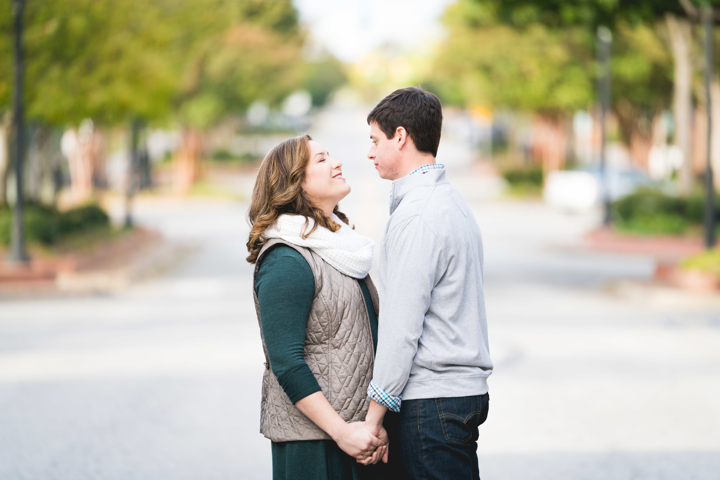 Couple in the street | Engagement Session Downtown Greenville, SC