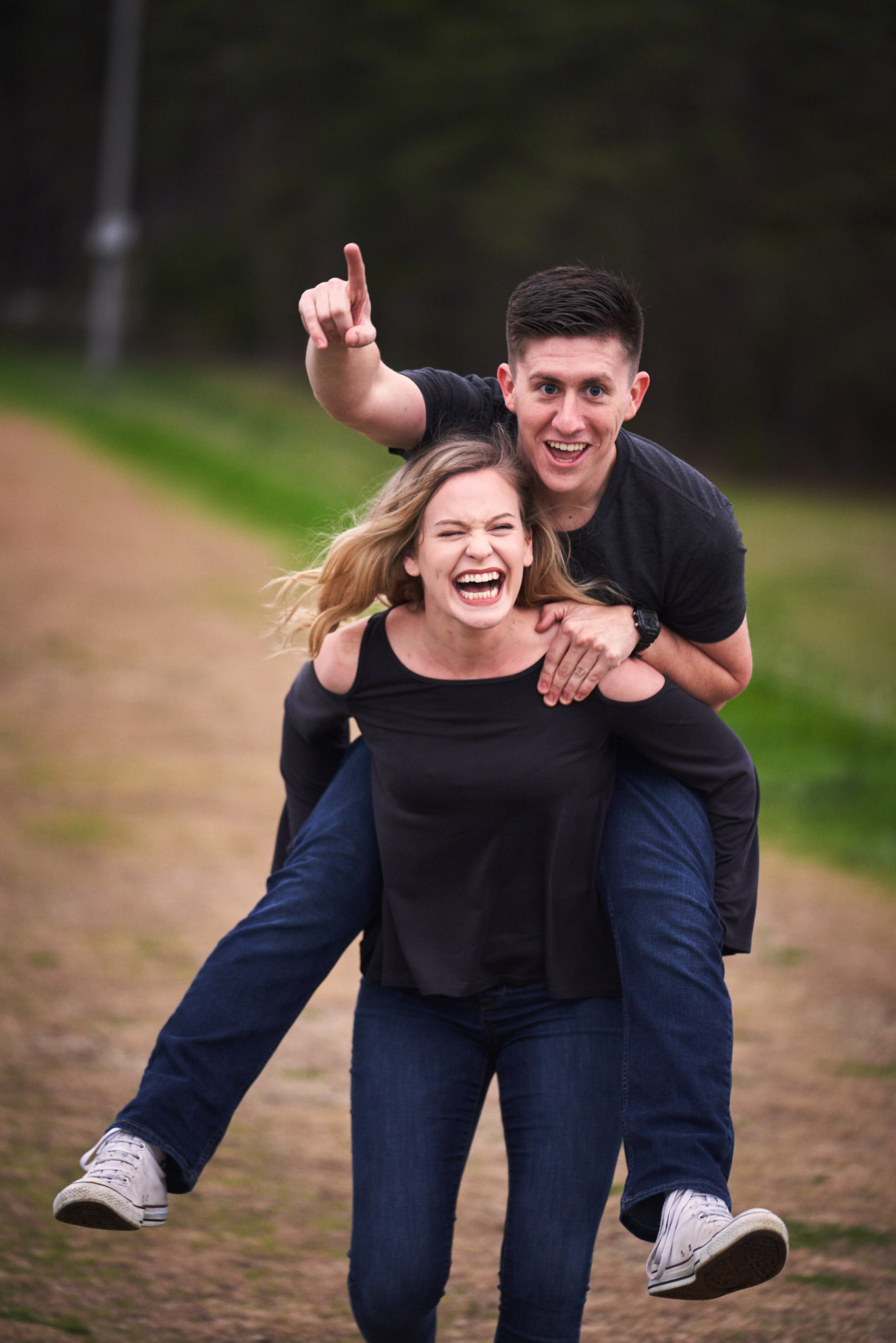 Couple piggyback ride | Engagement Session in Clemson, SC