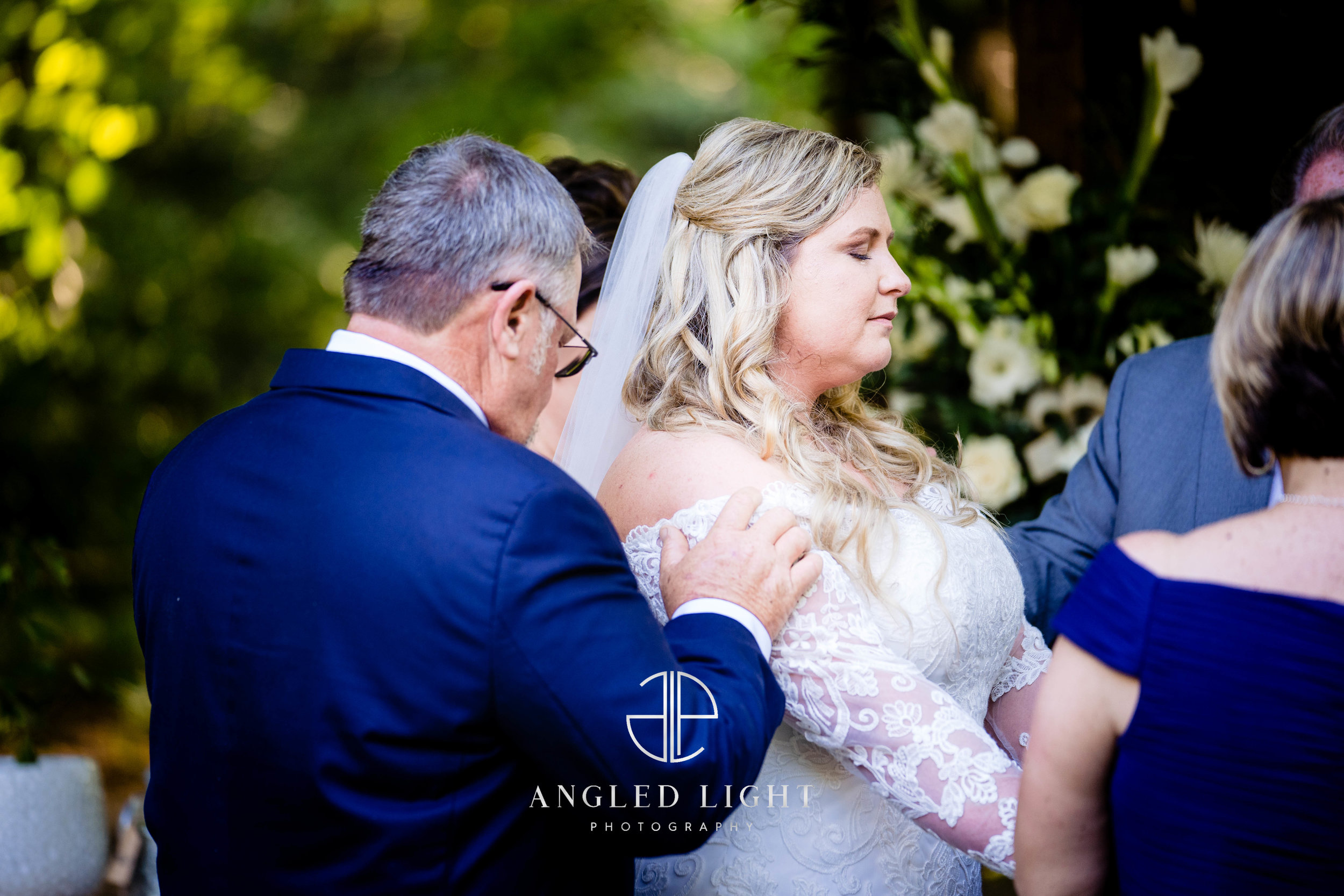 Prayer during ceremony | The Barn at Greene Acres in Honea Path, SC