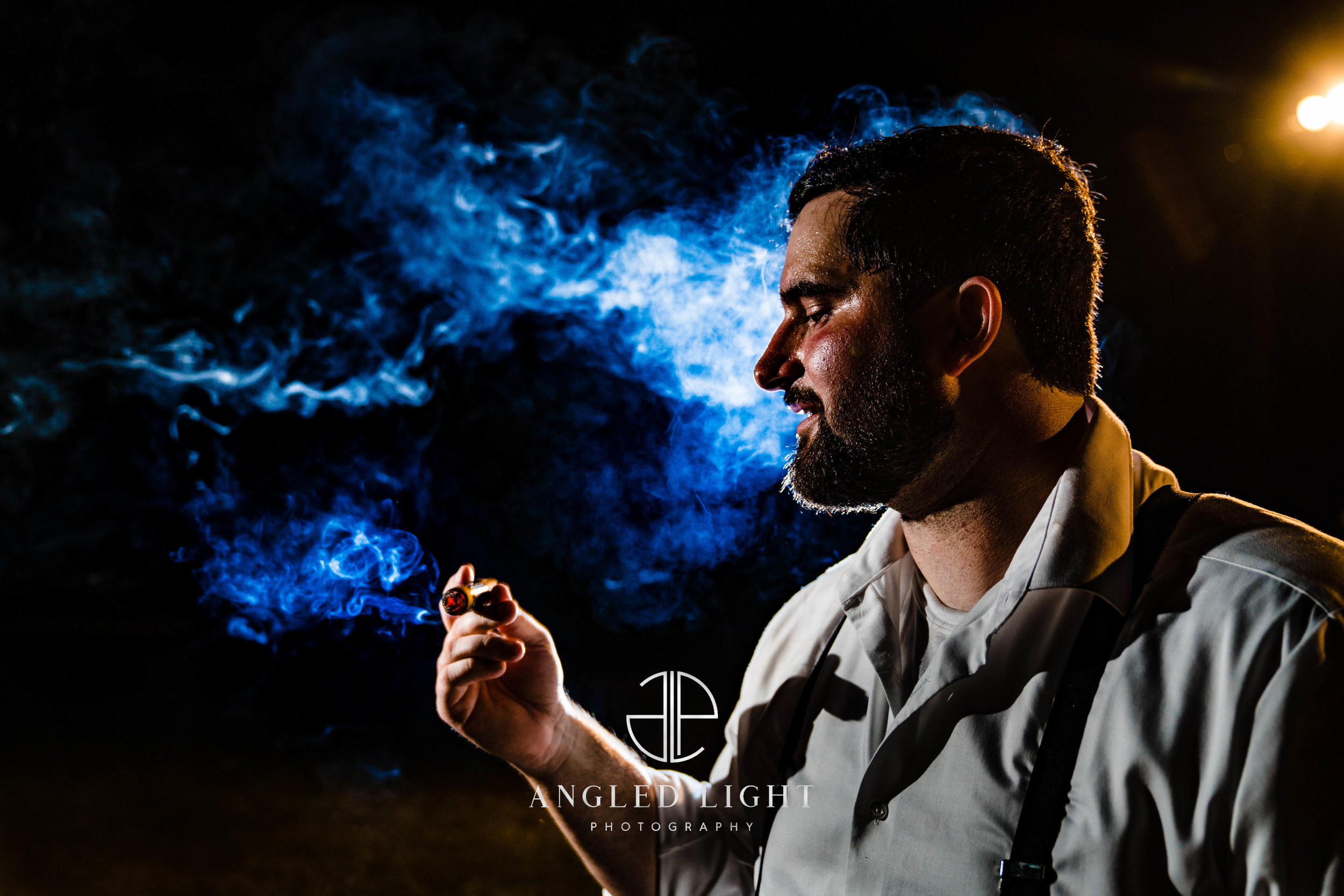 Groom smoking a cigar | The Barn at Greene Acres in Honea Path, SC