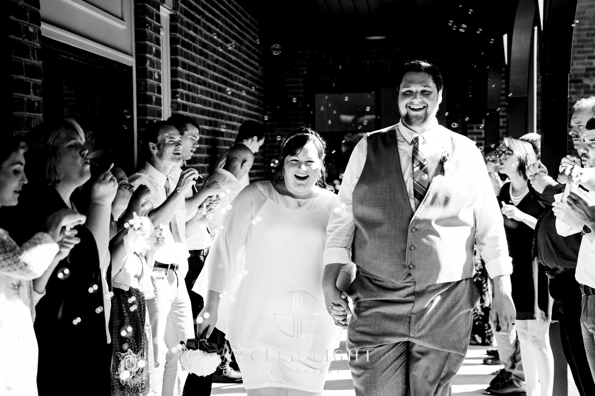 Bride and Groom leaving the reception