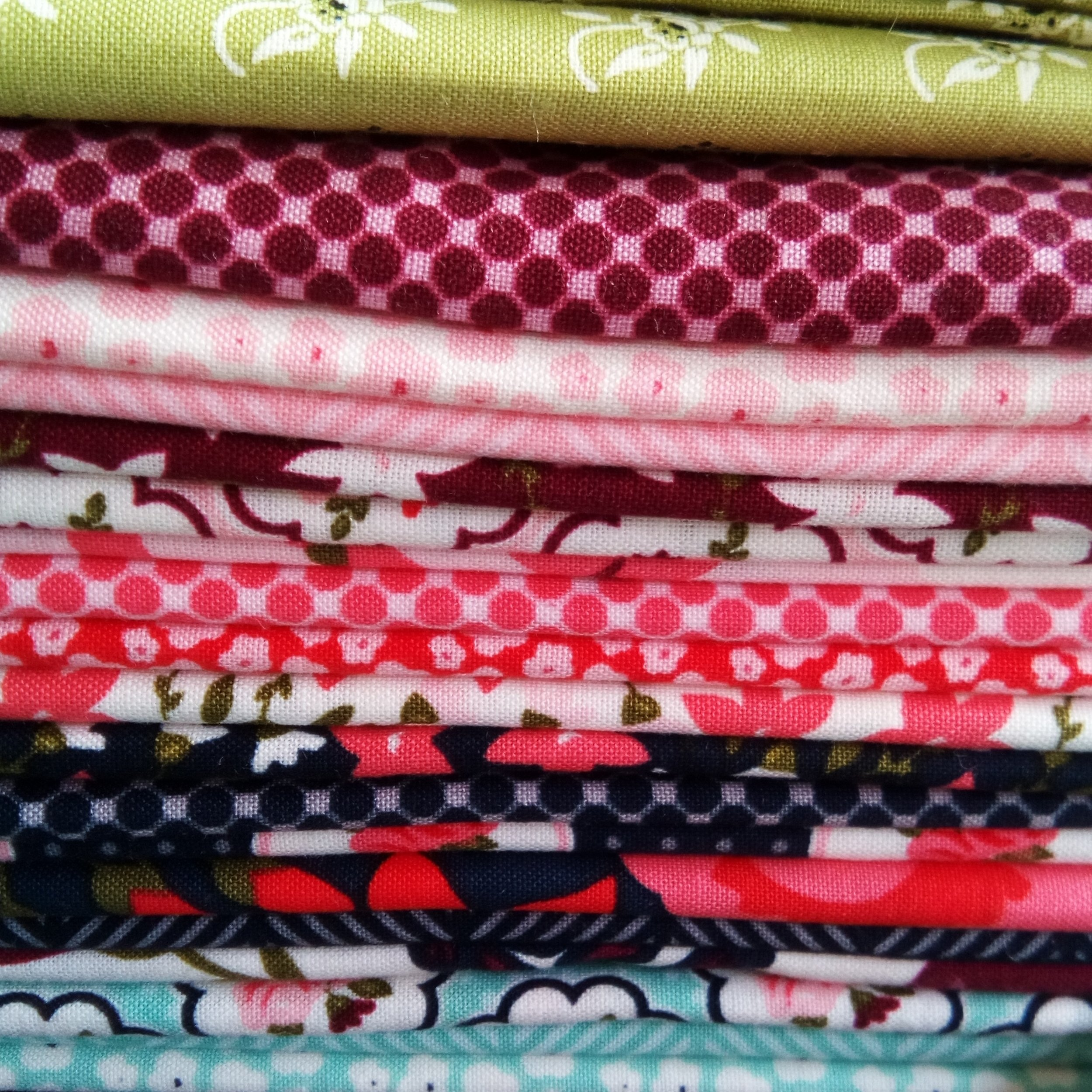 "I chose to use a fat quarter bundle of ""Posy Garden"" by Carina Gardner for Riley Blake Fabrics. The green fabrics I'll be using for stems and leaves are all scraps."