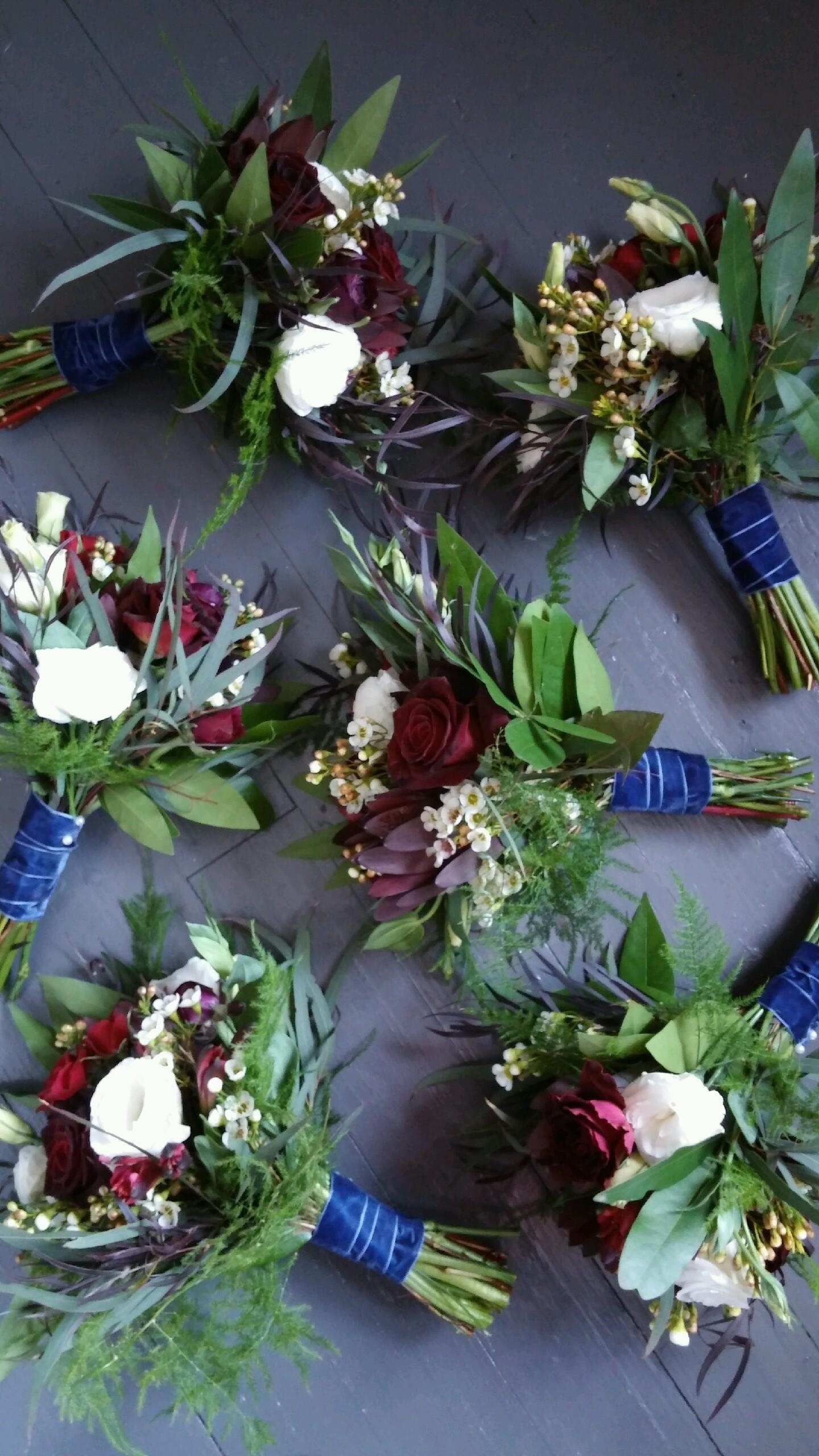 White, dark red bridesmaids bouquets  Jessica Wonders Events, Minneapolis, MN