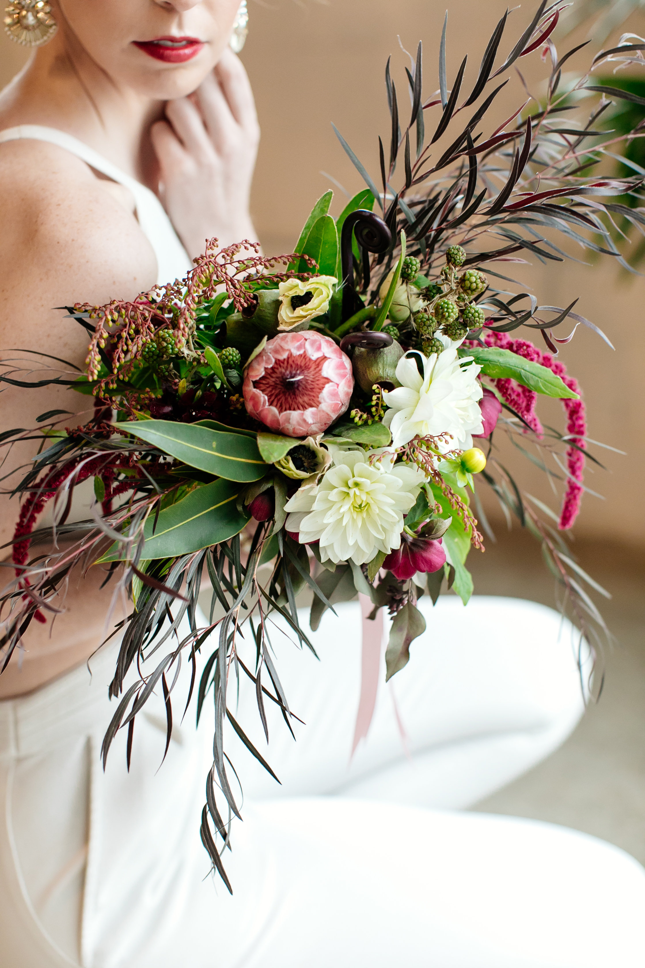 Protea, ivory, greenery, dark and light bridal bouquet,  Jessica Wonders Events, Minneapolis, MN