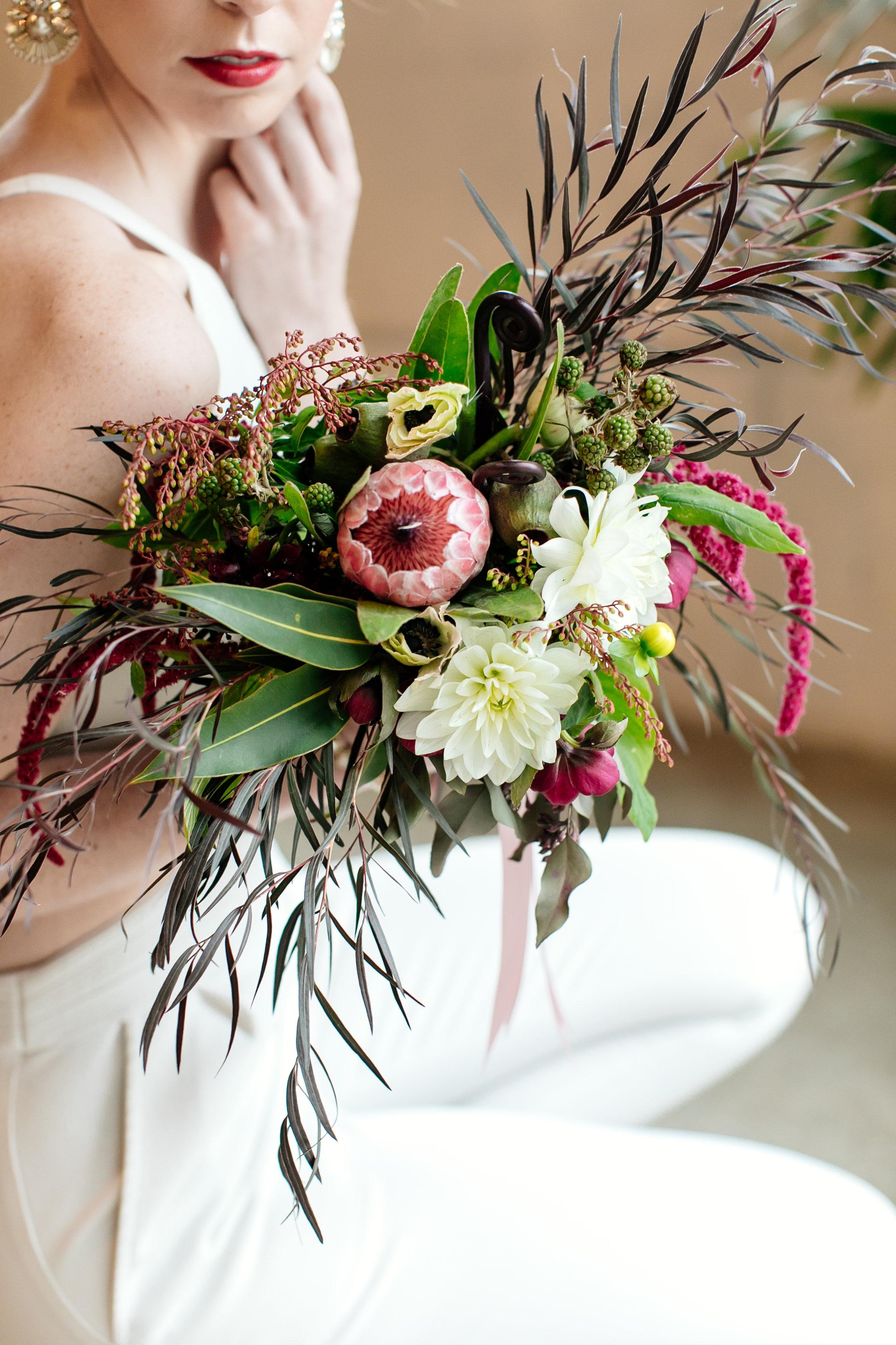 Protea, ivory, greenery, dark and light bridal bouquet,  Jessica Wonders Events, Minneapolis, MN