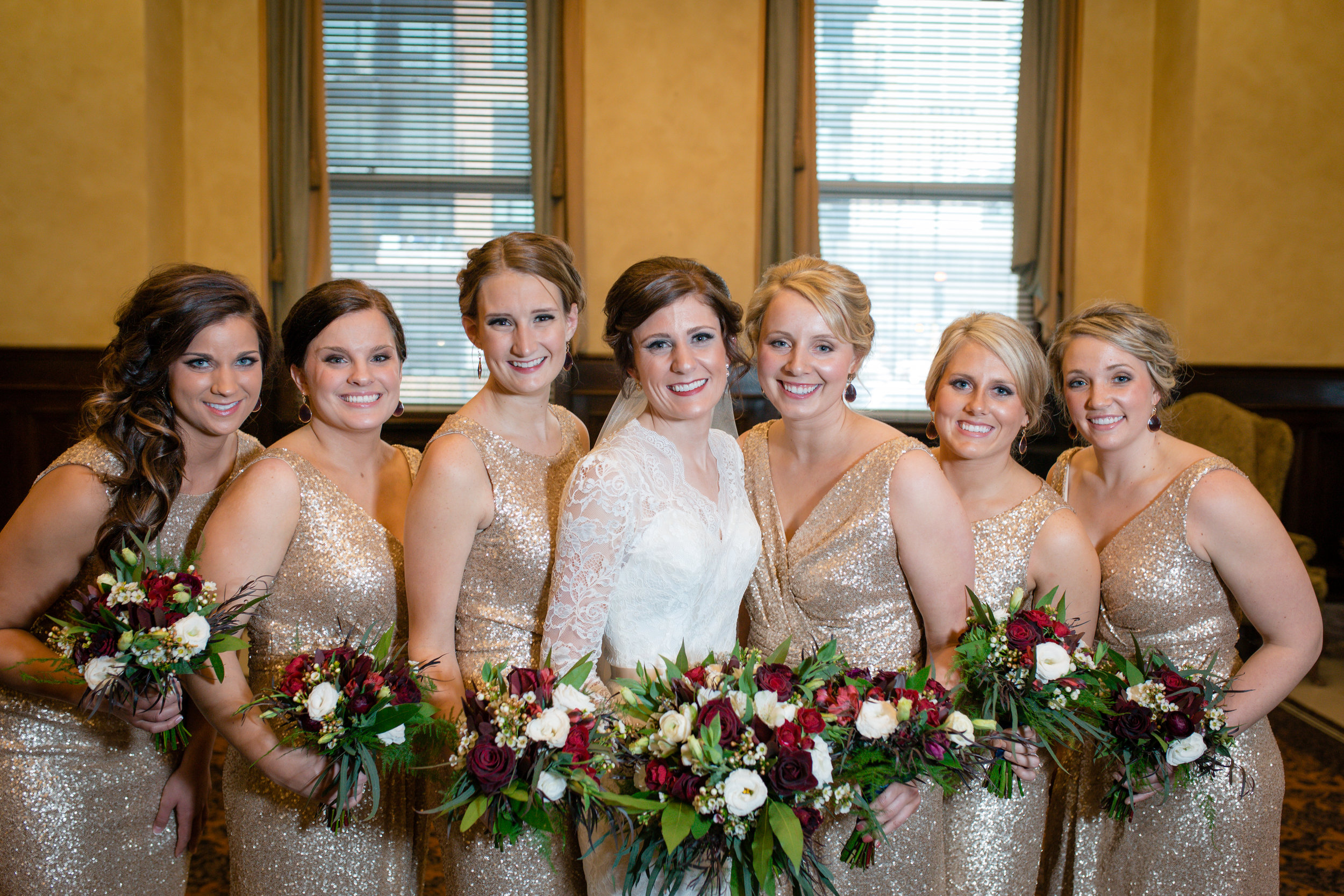 Red, ivory and greenery bridesmaids bouquets  Jessica Wonders Events, Minneapolis, MN