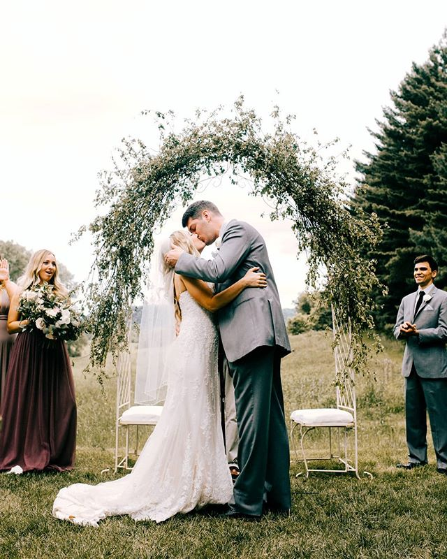 Simple greenery for your ceremony arch is always a good choice.  Floral @asterwonders  PC @karrahkobusphoto  Venue @roundbarnwedding