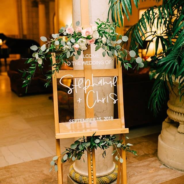 Simple floral on the cutest sign! Floral @asterwonders  Photo @whimsandjoy