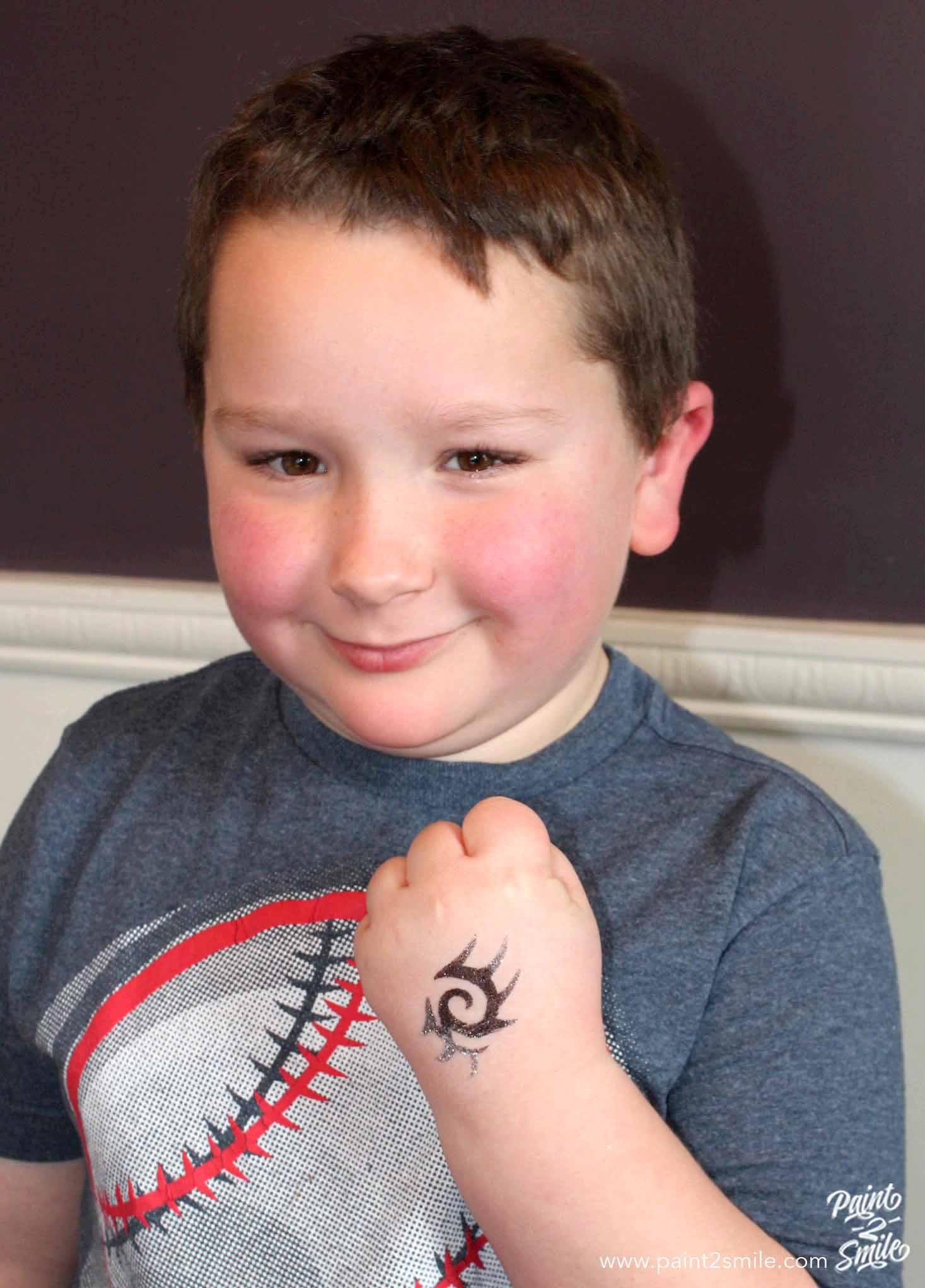 boy with tribal design glitter tattoo