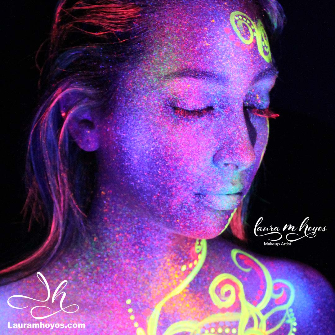 uv glow face painting of girl