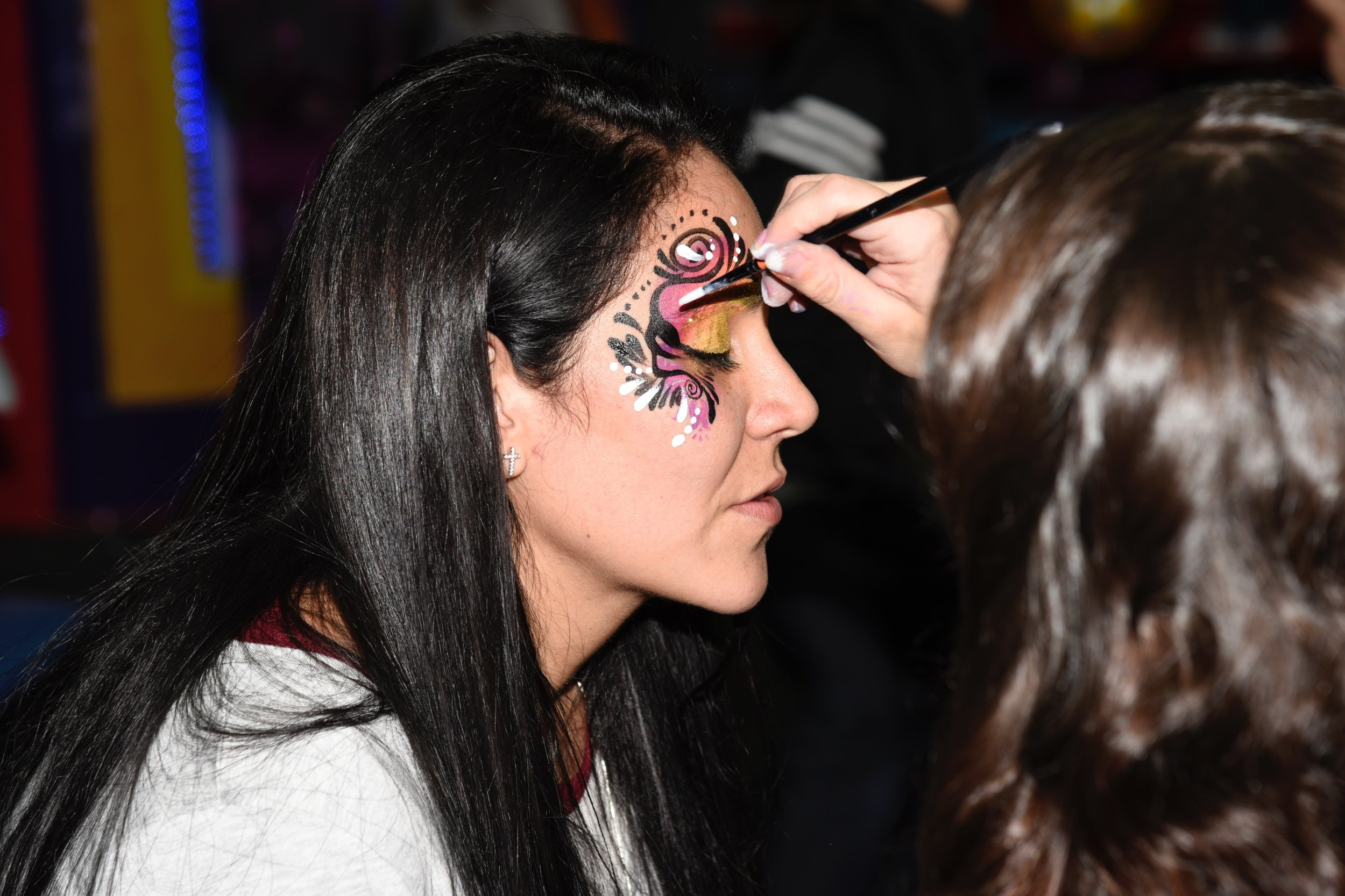 Laura M Hoyos face painting an adult