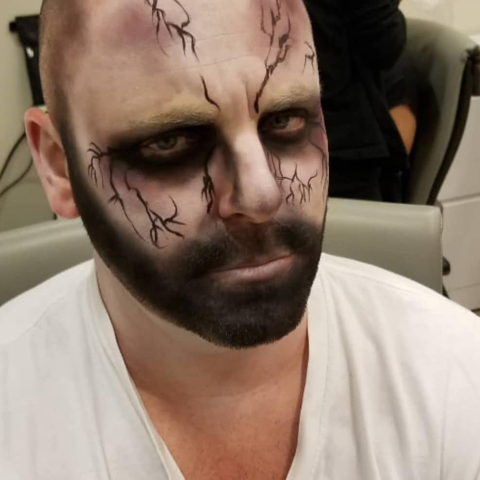 adult halloween makeup of a zombie