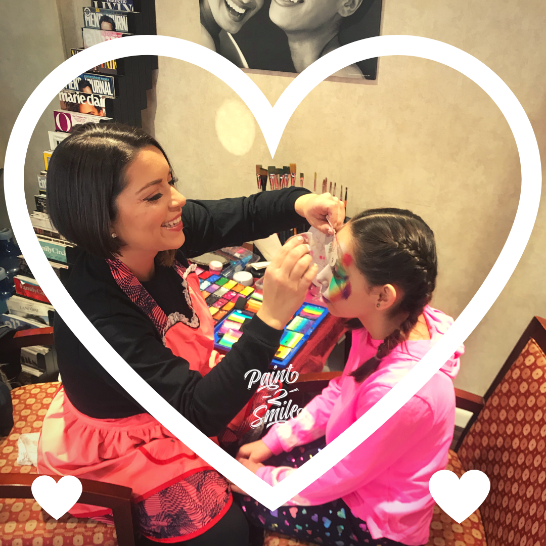 Paint 2 Smile artist Laura M Hoyos face painting a girl