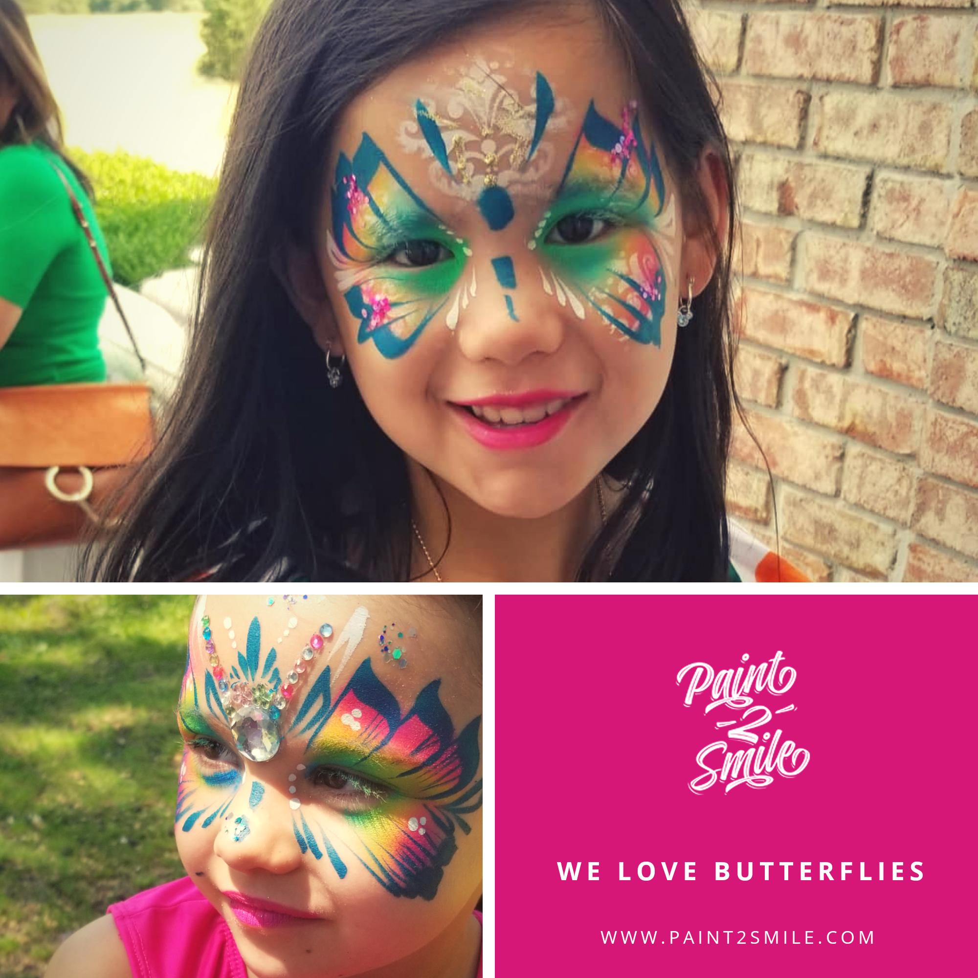 girls face painted as butterflies