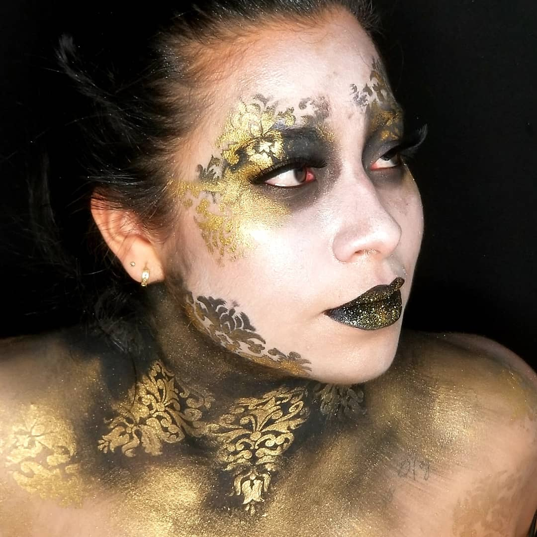 black and gold creative makeup