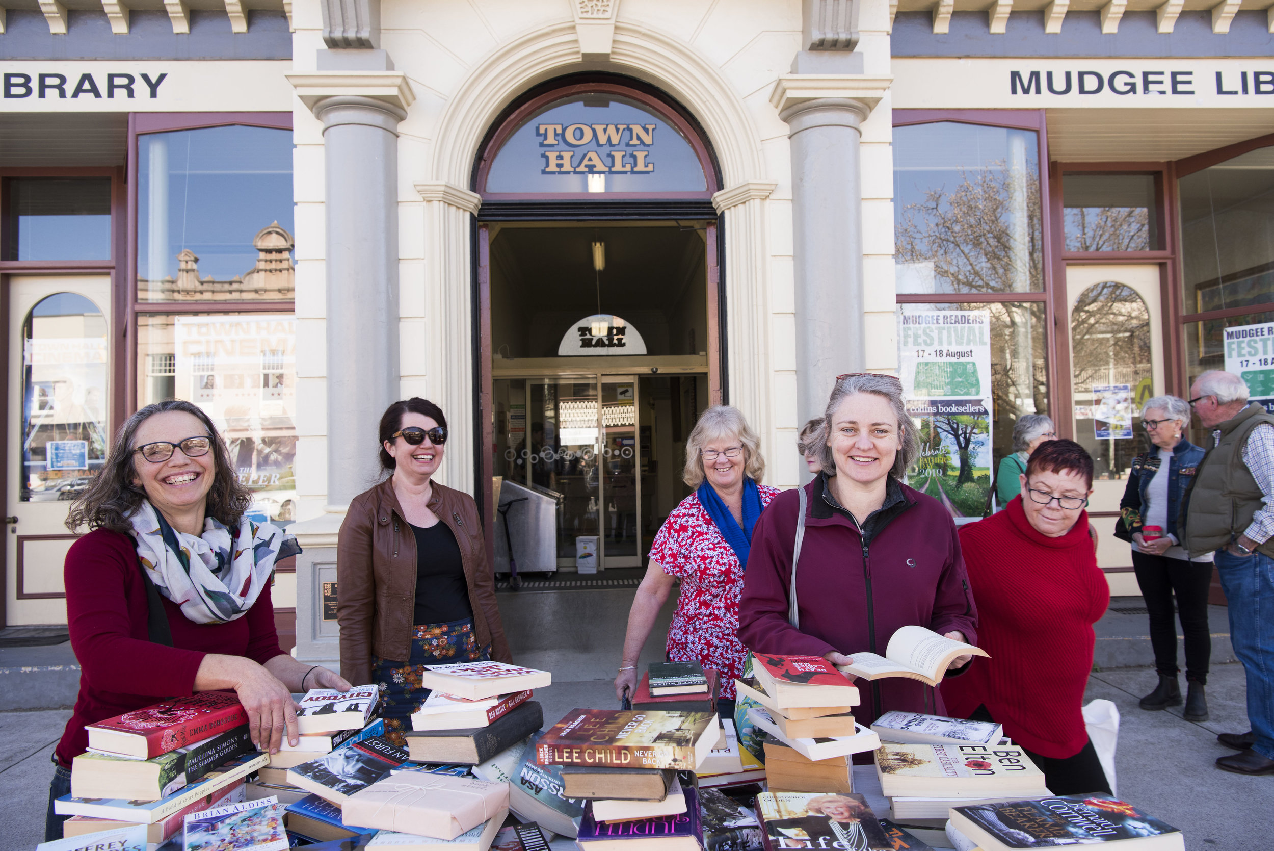 Happy readers at the MRF Book Swap Bench outside the Mudgee Library
