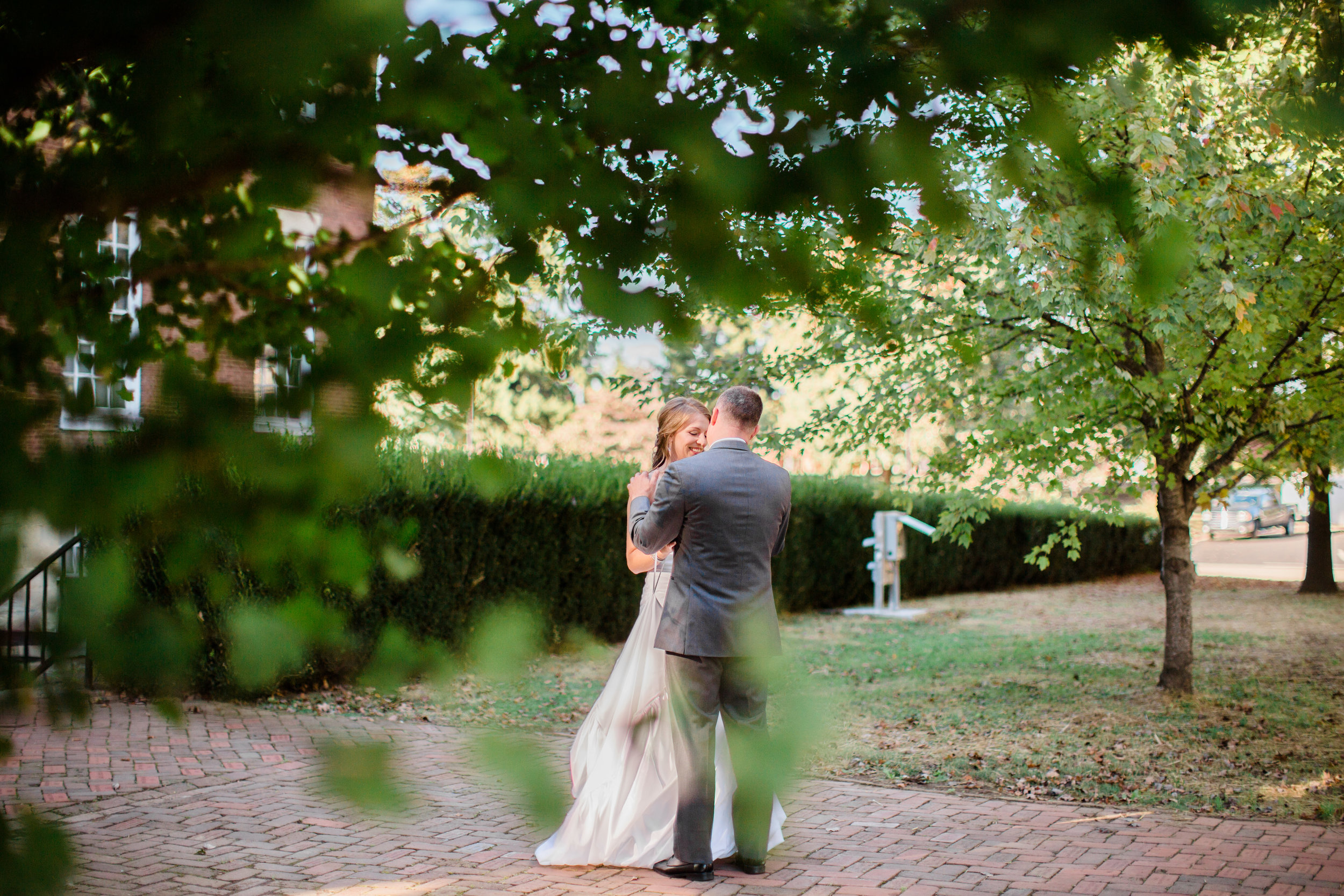 Bride and groom lovingly embrace and talk during first look