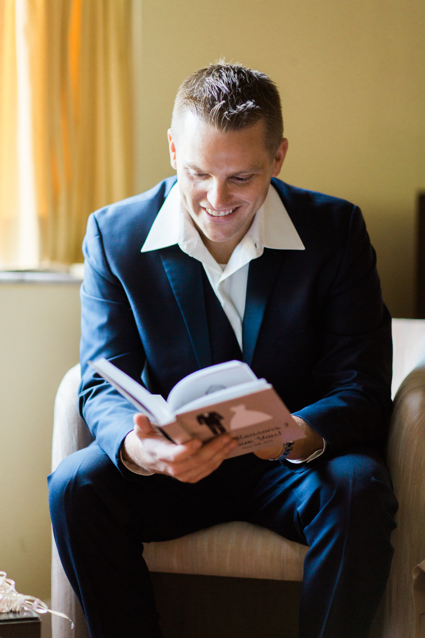 Groom reads personalized wedding book from the bride