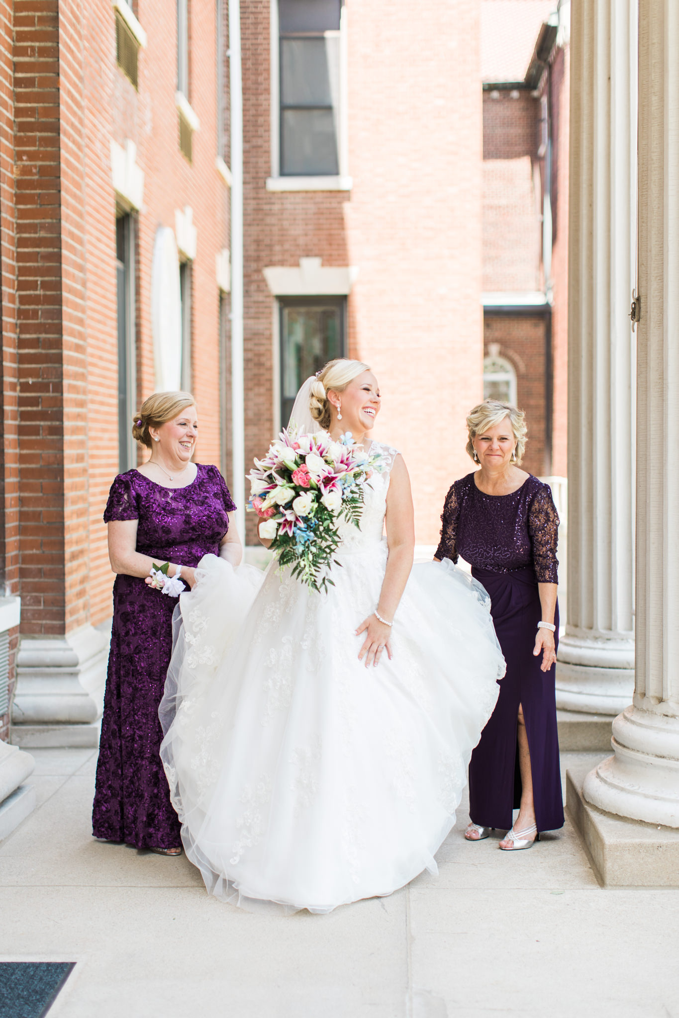 Mother of the Bride laughing with the Bride and the Mother of the Groom at St. Agnes Catholic Church in Louisville Ky
