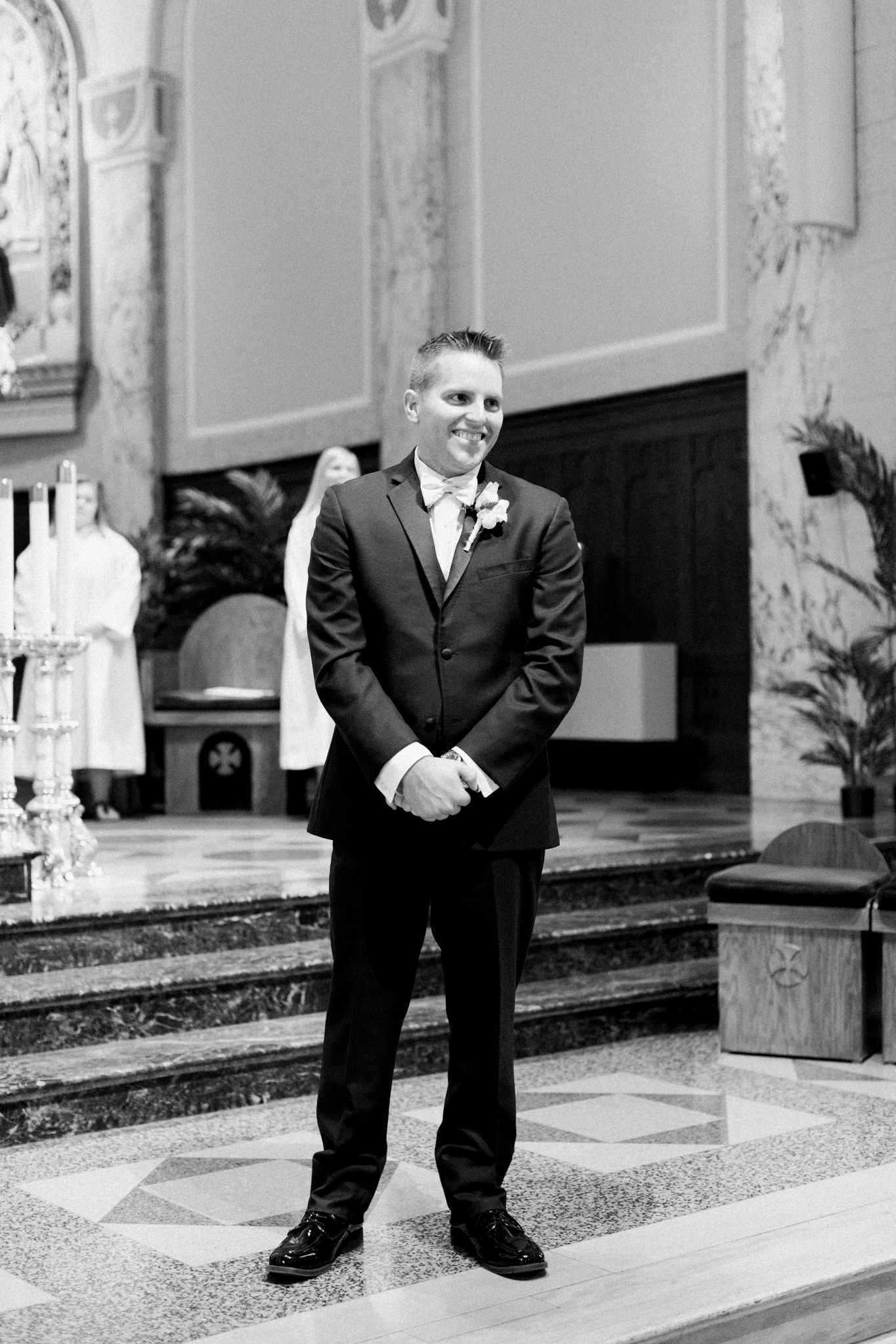 groom's first look, first sight of bride coming down the aisle at St. Agnes Catholic Church in Louisville Ky.
