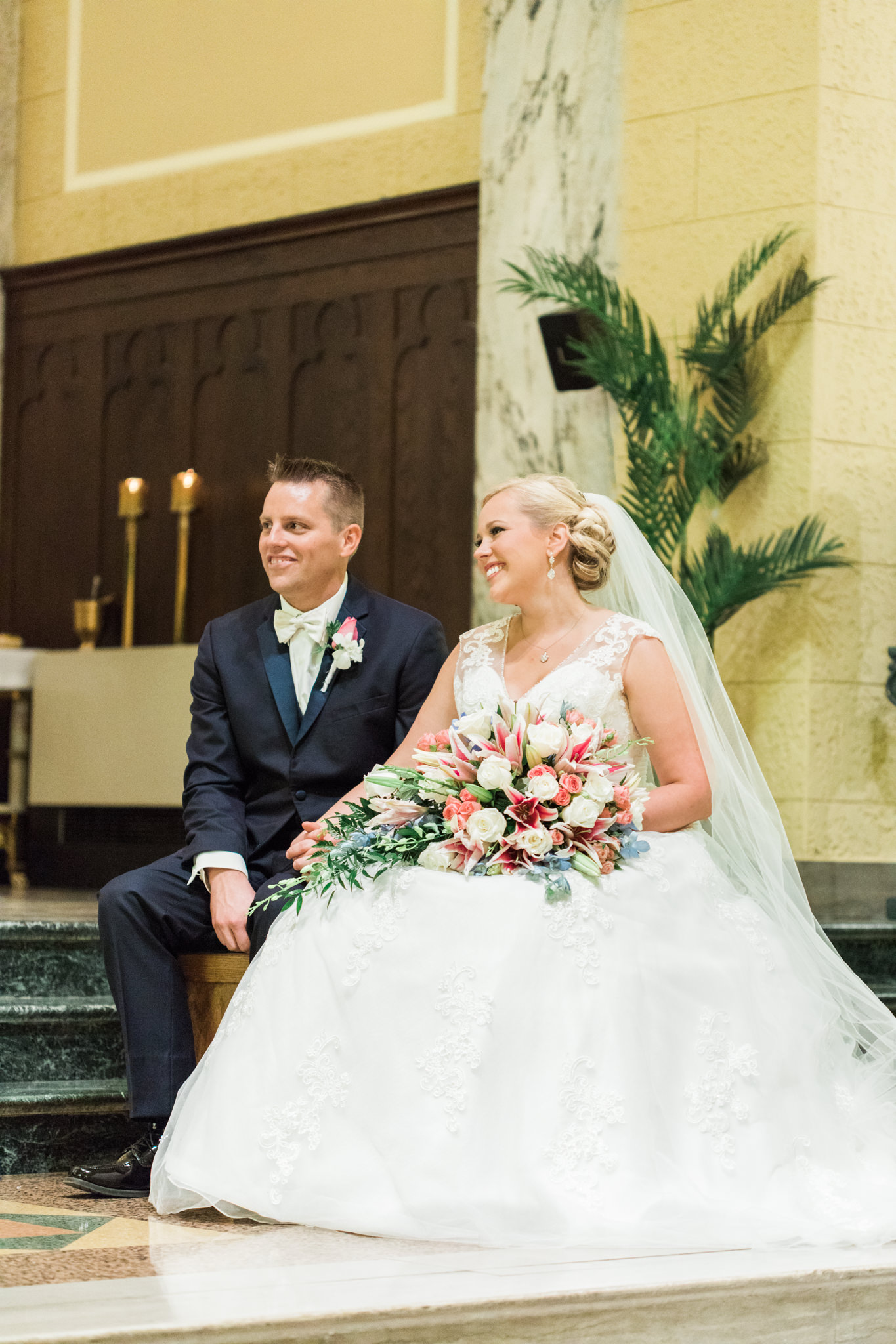 Bride and Groom sitting at their wedding at St. Agnes Catholic Church in Louisville Ky.