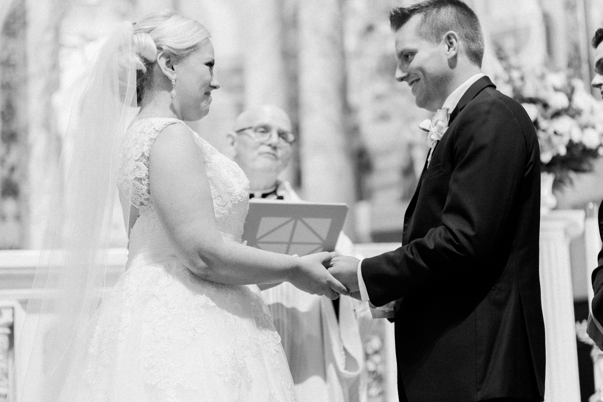 Up close shot of Bride and groom saying their vows at St. Agnes Catholic Church in Louisville ky.