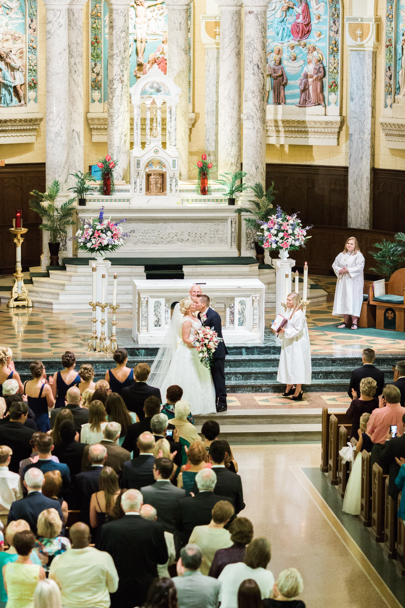 Bride and Groom first kiss from Balcony at St. Agnes Catholic Church in Louisville Ky.