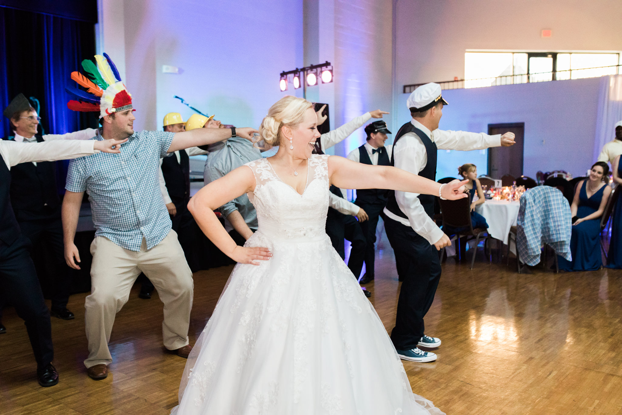 Groomsmen performing as the village people at Bellarmine wedding reception in Louisville ky