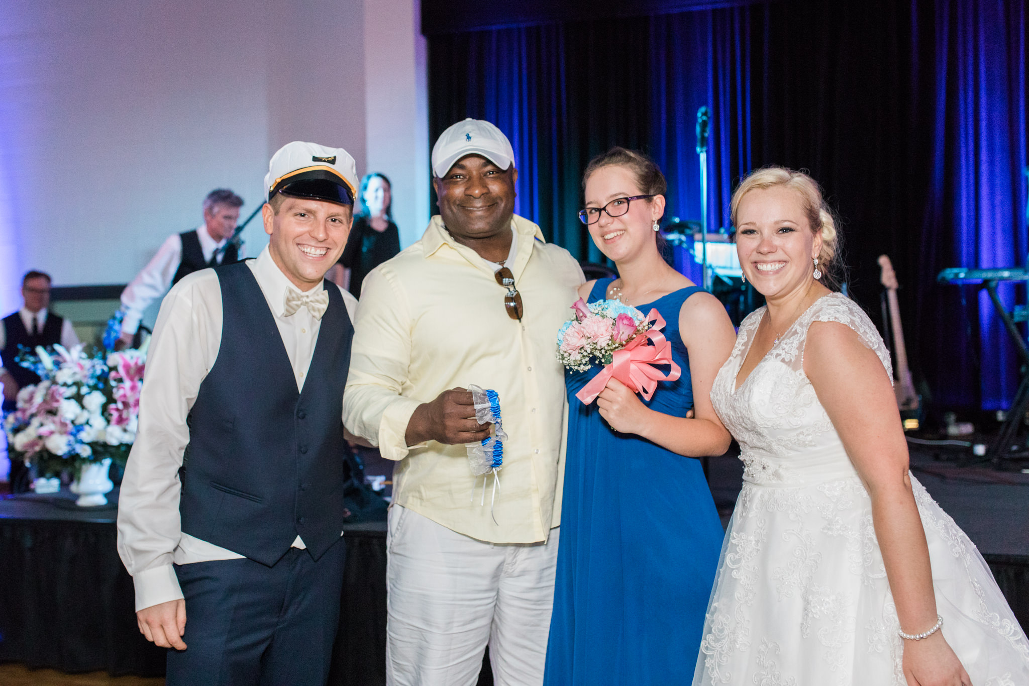 Garter toss and bouquet toss winners with bride and groom at Bellarmine wedding reception in Louisville Ky