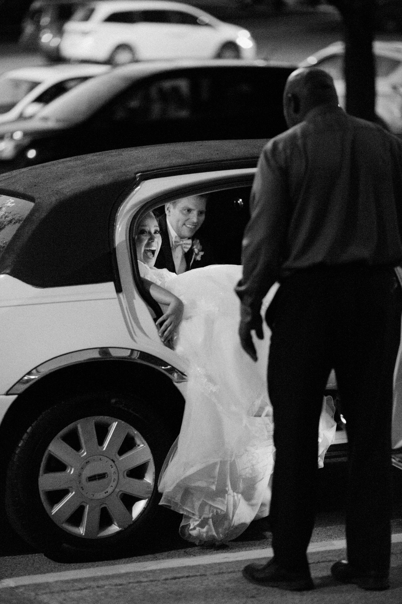 bride falling into limo at the end of the night after her louisville ky wedding