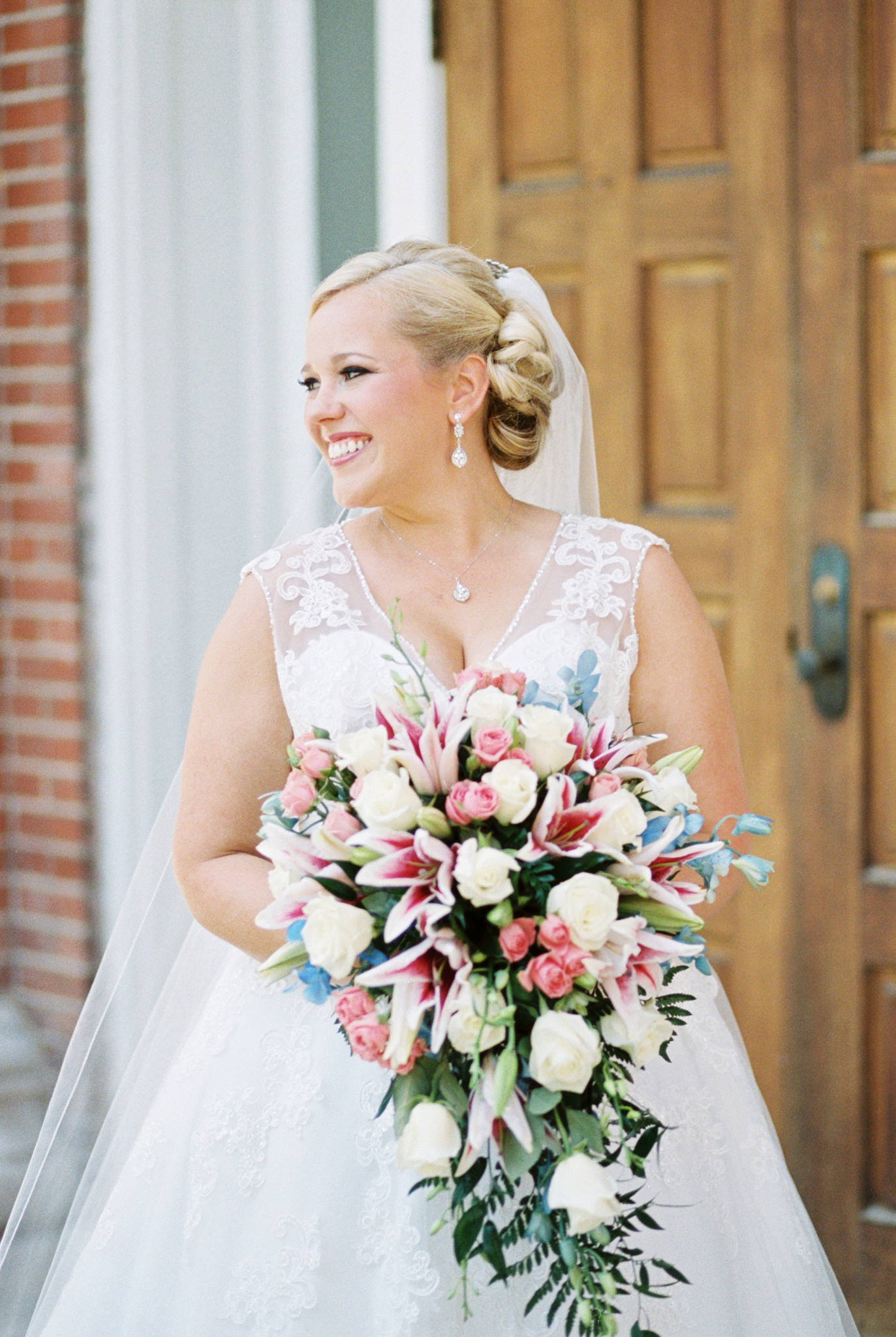 bride holding cascading bouquet at louisville ky wedding St. Agnes CAtholic church