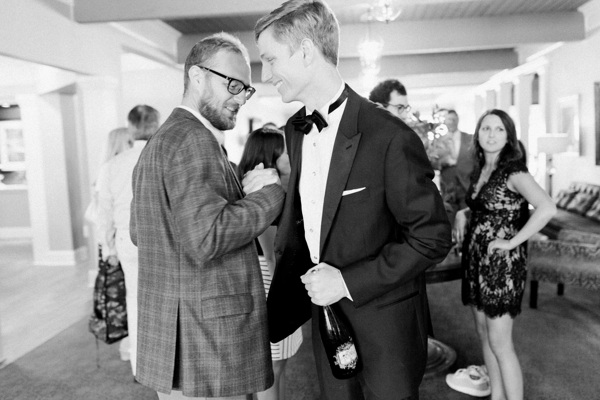 handshake candid at little turtle club wedding in columbus ohio